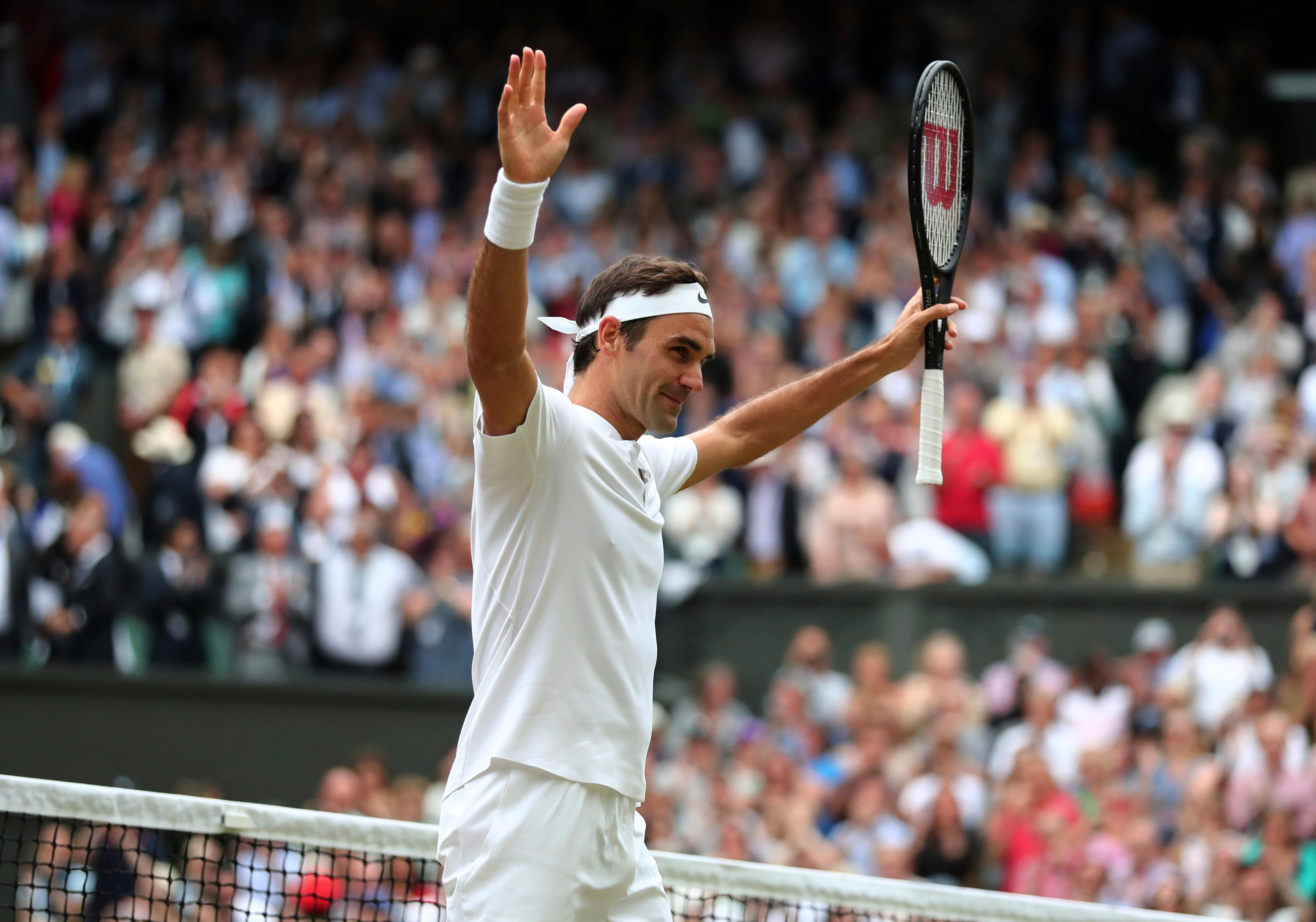 Switzerland's Roger Federer celebrates after beating Czech Republic's Tomas Berdych in their Men's Singles semifinal match on day eleven at the Wimbledon Tennis Championships in London, Friday, July 14, 2017. (Gareth Fuller/Pool Photo via AP)