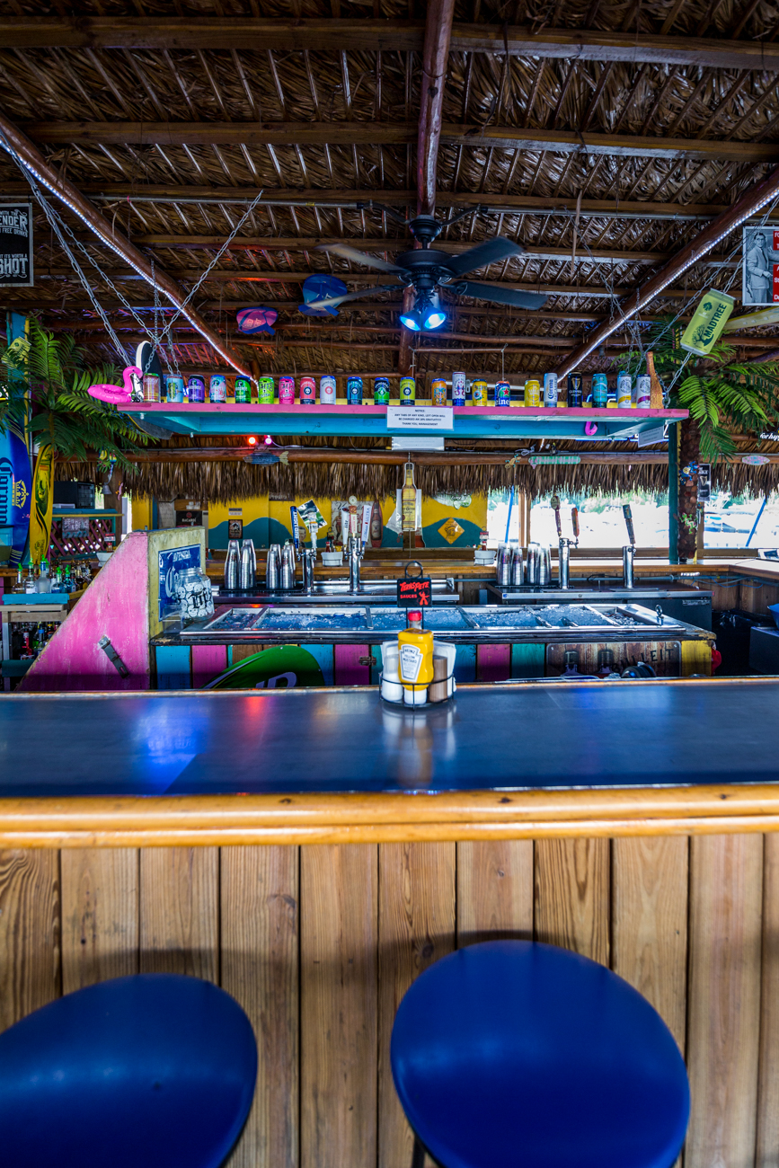 <p>PLACE: Pirate's Cove Tropical Bar & Grill / ADDRESS: 4609 Kellogg Avenue (East End) / Pirate's Cove is Key West-inspired and located at the Four Seasons Marina. The festive spot offers an open patio with excellent water views, live music and entertainment, and a broad menu featuring seafood and American fare. You may even spot a friendly pirate wandering around if you're lucky. / Image: Catherine Viox // Published: 7.18.19</p>