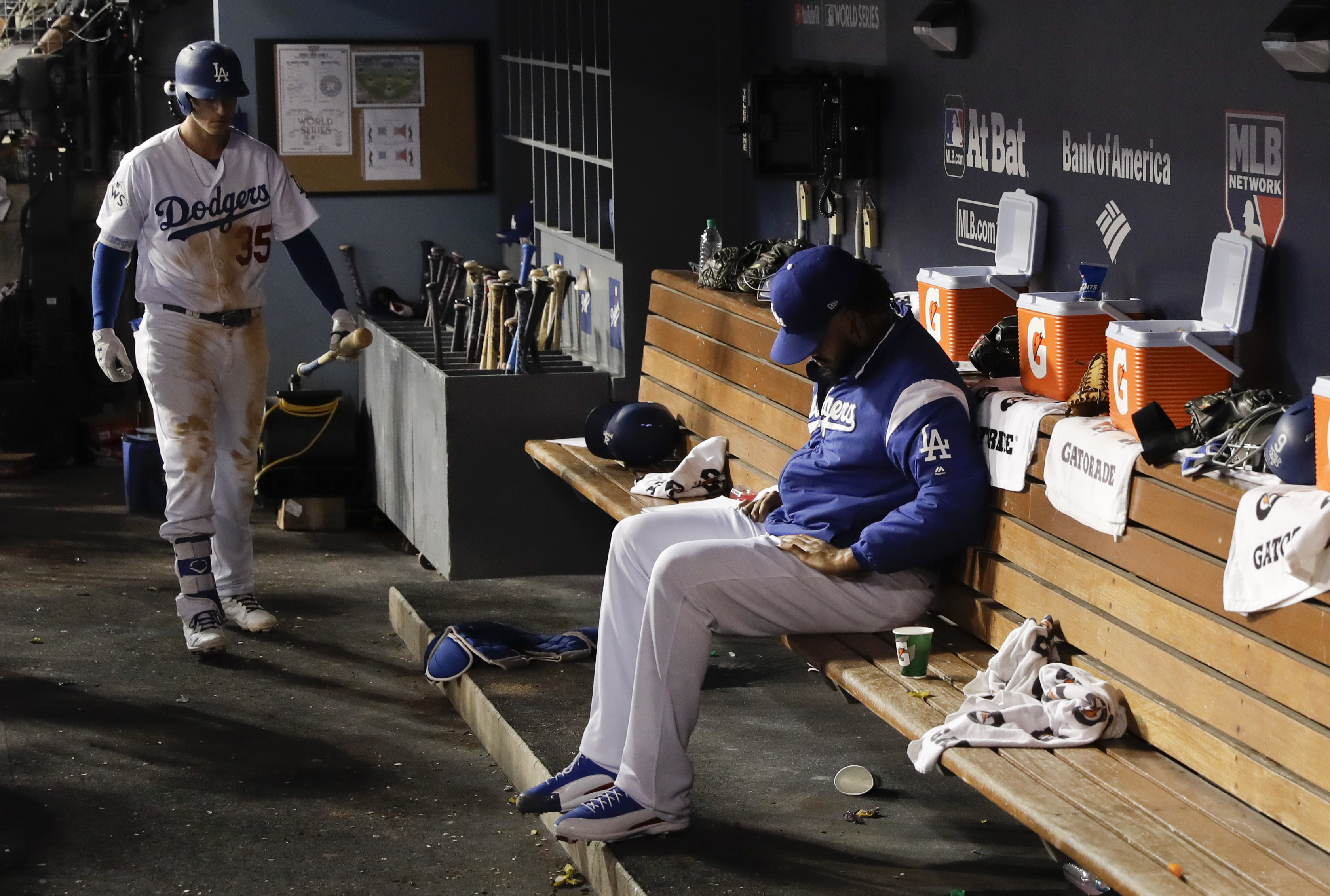 Los Angeles Dodgers relief pitcher Kenley Jansen sits in the dugout during the ninth inning of Game 2 of baseball's World Series against the Houston Astros Wednesday, Oct. 25, 2017, in Los Angeles. (AP Photo/Matt Slocum)