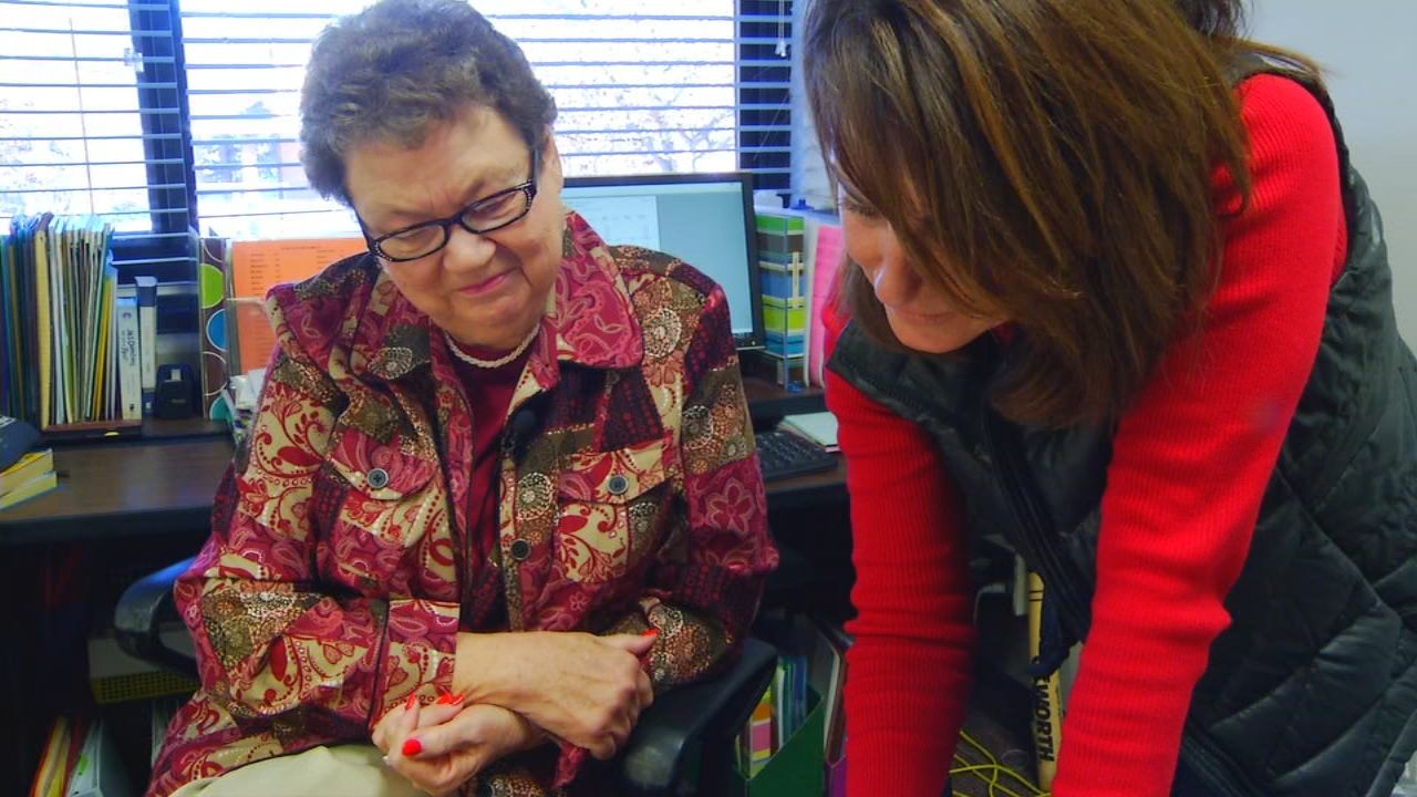 Carol Buckner (LEFT) has been the keeper of the community's history and the school's history for over 50 years. (Photo credit: WLOS Staff)