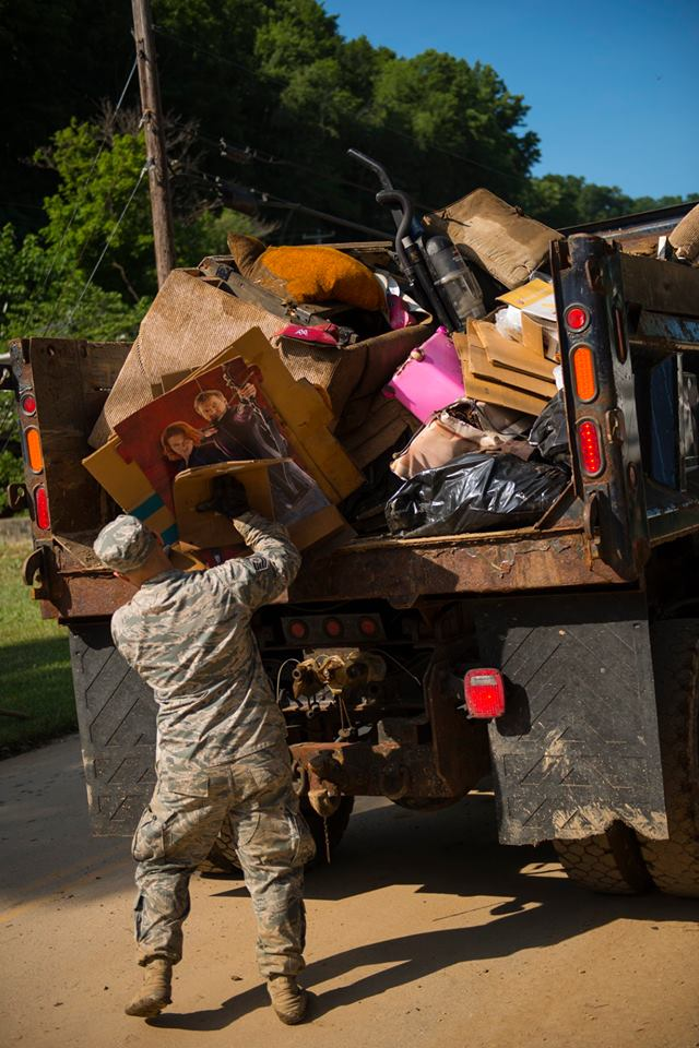 A National Guard member loads items on a truck during flood recovery efforts in Clendenin. (West Virginia National Guard)