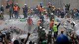 In Mexico, rescuers battle to extract victims from rubble