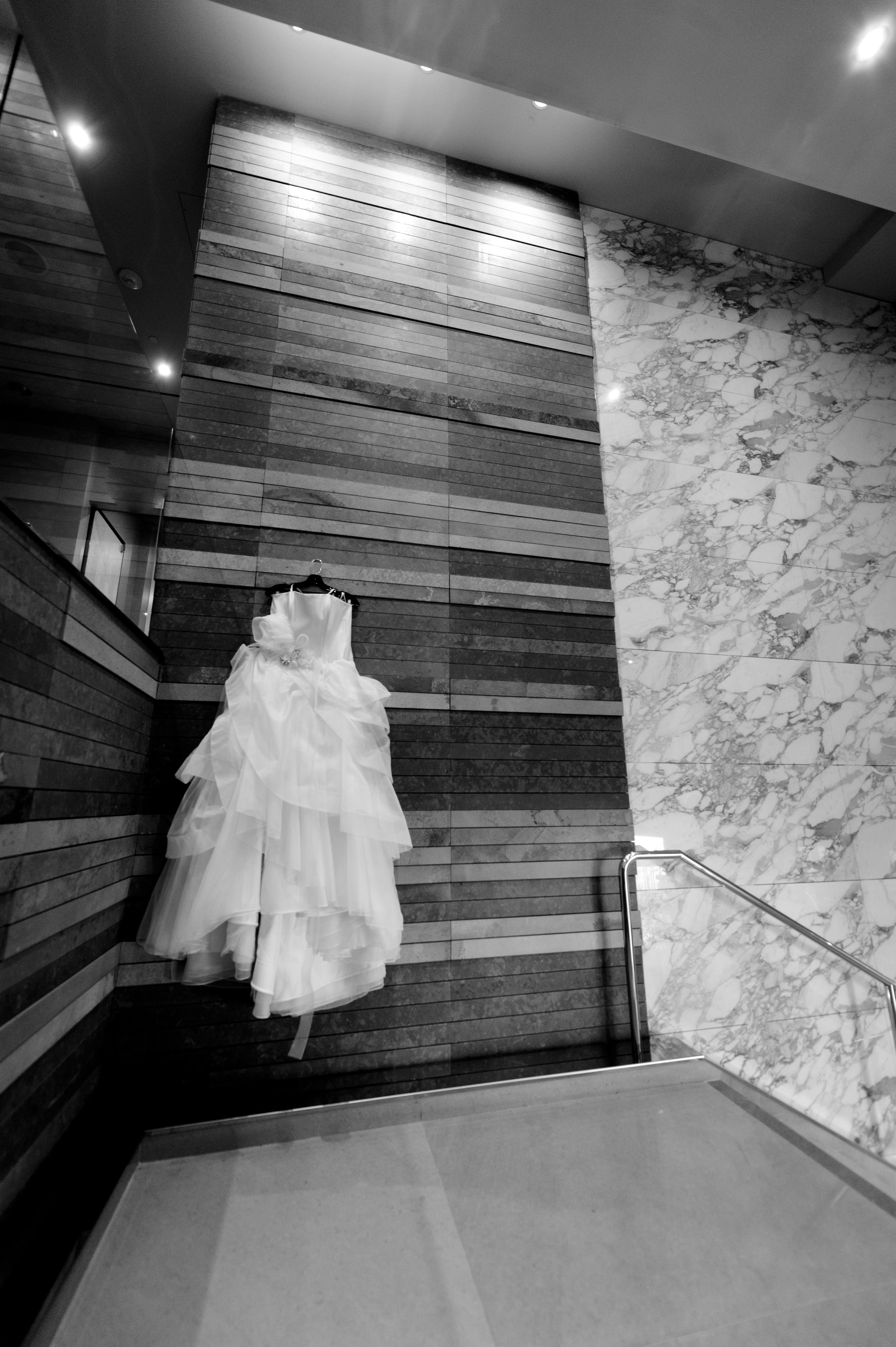Eli and Ann Ebreo had the perfect most quintessential Seattle wedding, taking pictures in Nordstrom (which is strictly not allowed, but they got the hook up), the Four Seasons Hotel, and had views that overlooked the Sound and the Great Wheel. The couple then hopped in a bus with a wedding party and hit the town searching for different photo spots around the city. Could it get more Seattle then this?  Do you or somebody you know have a wedding you think deserves the spotlight? We LOVE (pun intended) documenting love stories, so email us at hello@seattlerefined.com to submit some wedding or engagement shots! (Image: Rick Takagi /http://ricktakagi.zenfolio.com/eli)