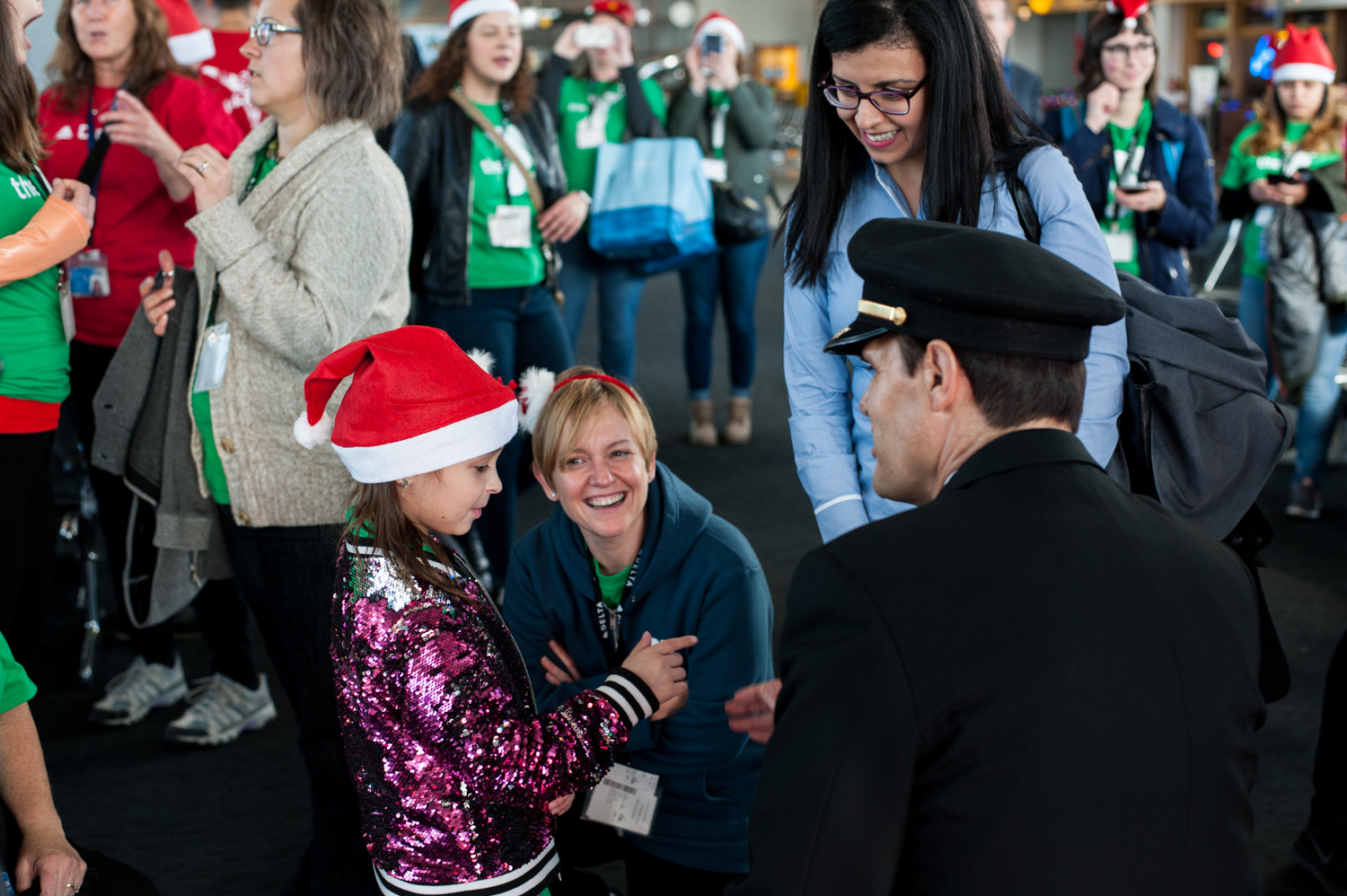 95 lucky elementary school students 'flew' to the 'North Pole' to meet Santa Tuesday, December 4, 2018. The kids, all from Washington Elementary School-Auburn, boarded a Delta plan at Sea-Tac, then taxied to their destination: a Delta hangar that had been transformed into a winter wonderland just for them. The kids played games, got gifts from Santa and visits from the Sea Gals, Seahawks and the Coca-Cola Polar Bear. Holiday in then Hangar is an annual event Delta puts on to support the community. (Image: Elizabeth Crook / Seattle Refined)