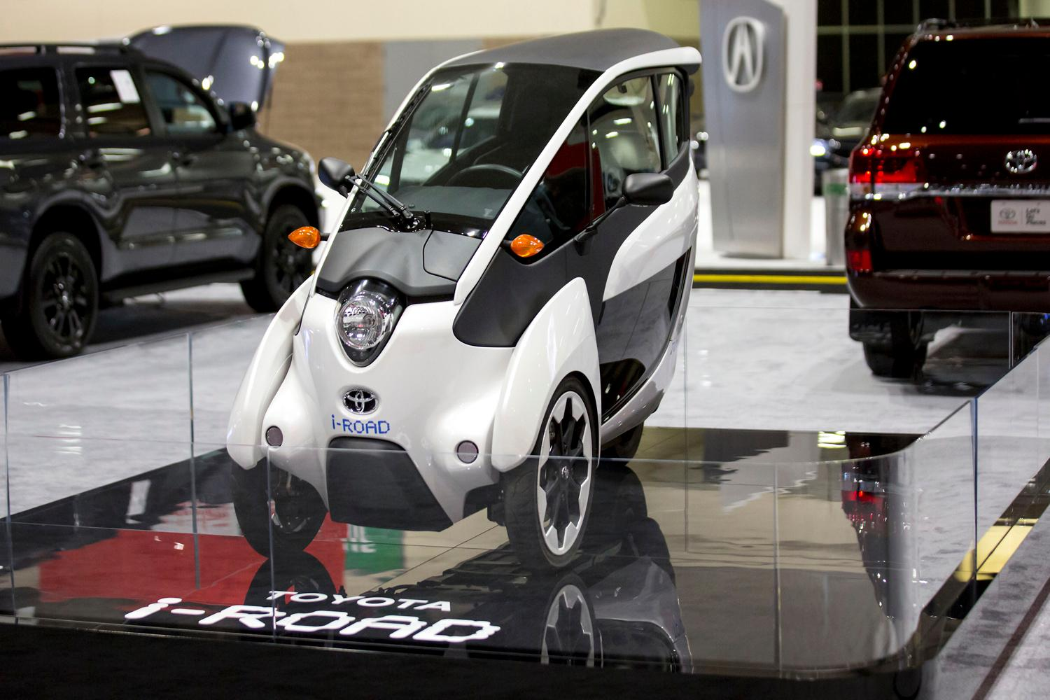 "The i-Road is Toyota's ""Personal Mobility"" car that is already hitting the streets in Japan and some locations in Europe, at the Seattle International Auto Show at the CenturyLink Event Center. (Sy Bean / Seattle Refined)"