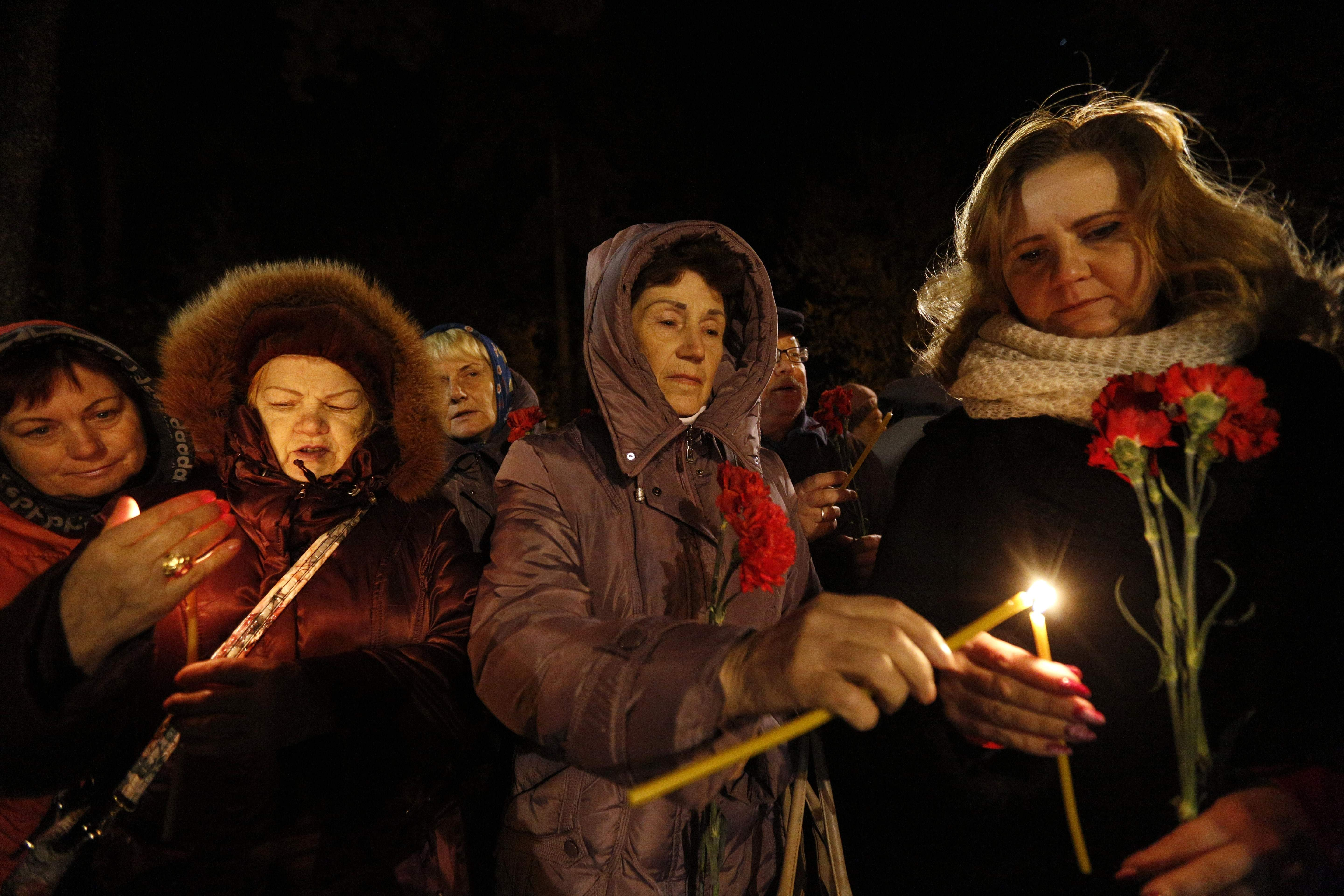 Ukrainians light candles at the memorial to the victims of the Chernobyl nuclear disaster, in Kiev, Ukraine, Wednesday, April 26, 2017. Ukraine marked the 31st anniversary of the Chernobyl nuclear power plant explosion. THE ASSOCIATED PRESS