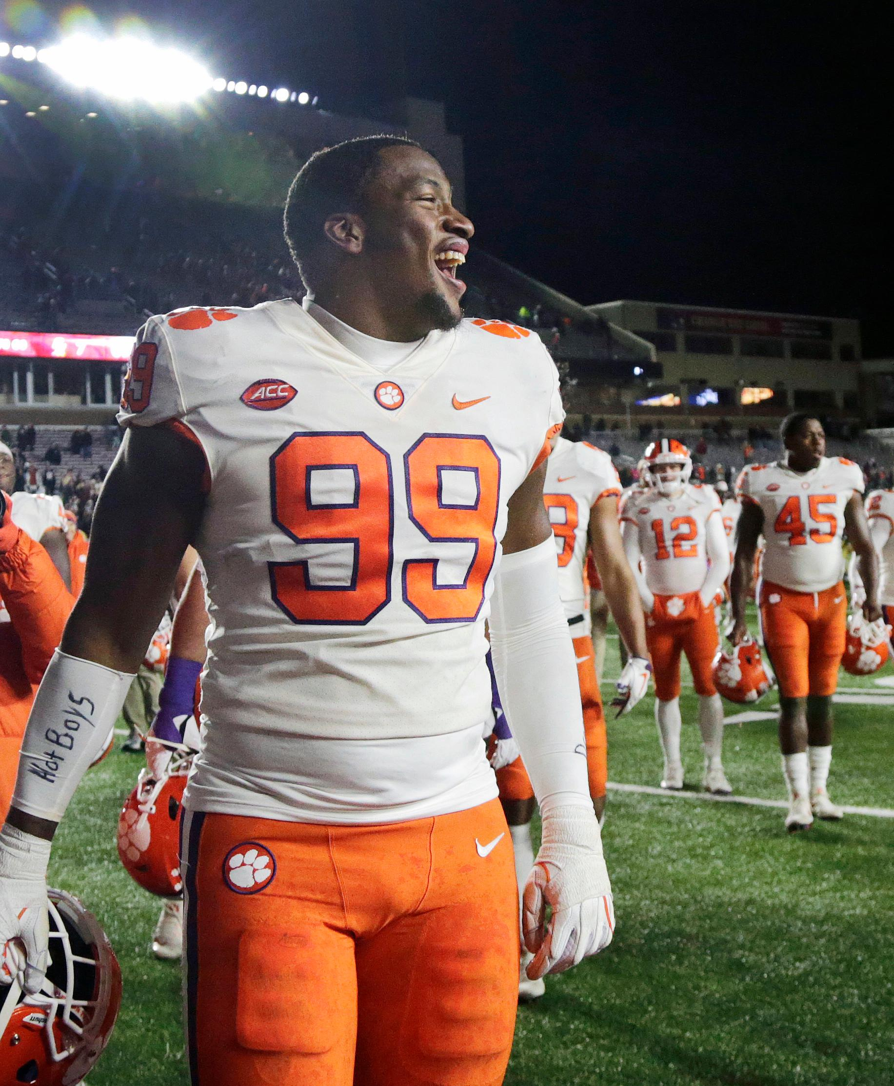 FILE - In this Nov. 10, 2018, file photo, Clemson defensive end Clelin Ferrell (99) and teammates celebrate their 27-7 victory over Boston College in a game in Boston. Ferrell was named to the 2018 AP All-America NCAA college football team, Monday, Dec. 10, 2018.(AP Photo/Elise Amendola, File)