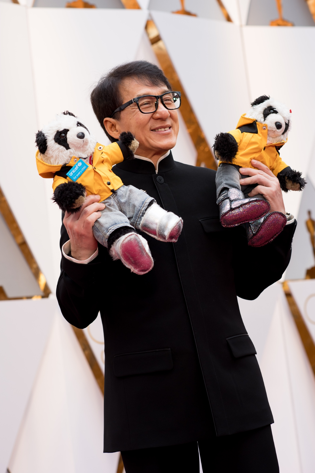 #27: Jackie Chan. To be clear, we are impressed that he brought stuffed animals to the red carpet. It's a great distraction technique away from the outfit (which actually isn't bad!). We're just confused. Please hold while we Google what in the world those were. (Image: AMPAS)