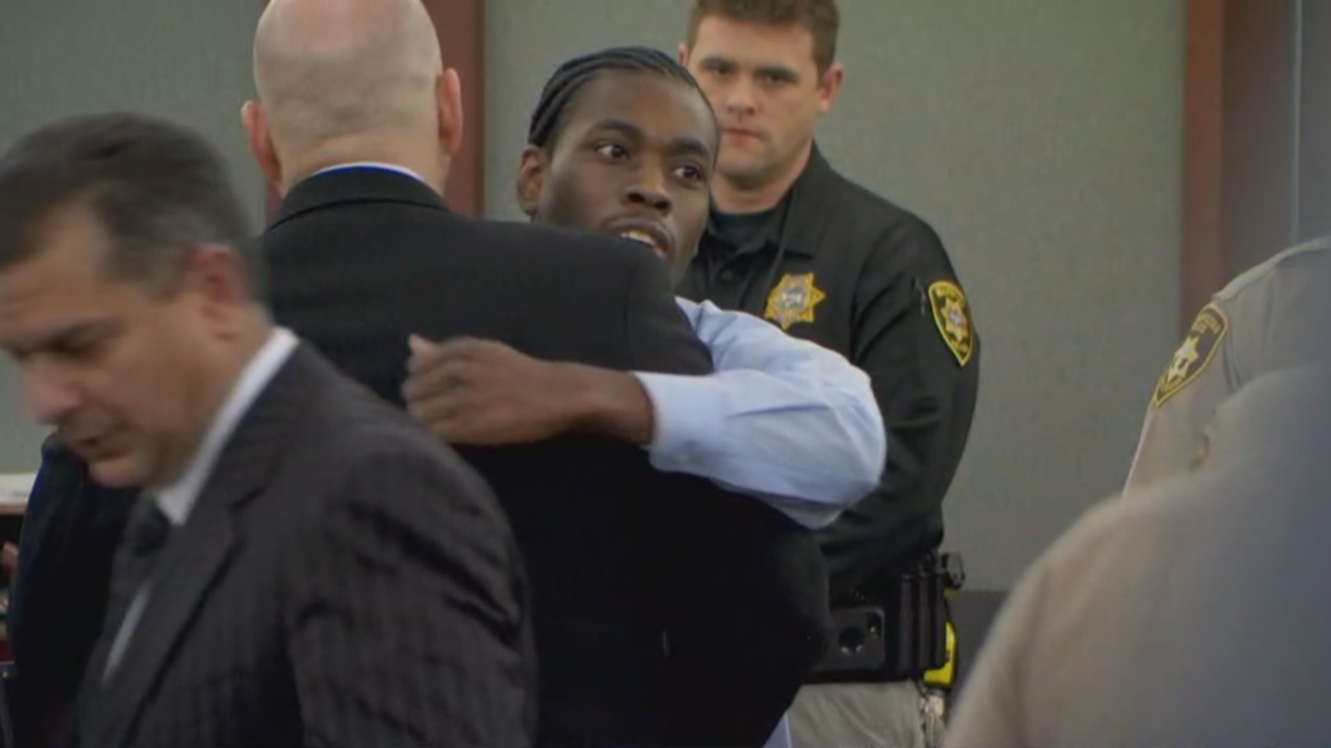 Bryan Clay hugs defense attorney Christopher Oram after receiving a verdict of life without parole Tuesday, December 5, 2017, at the Regional Justice Center in Las Vegas. (KSNV)