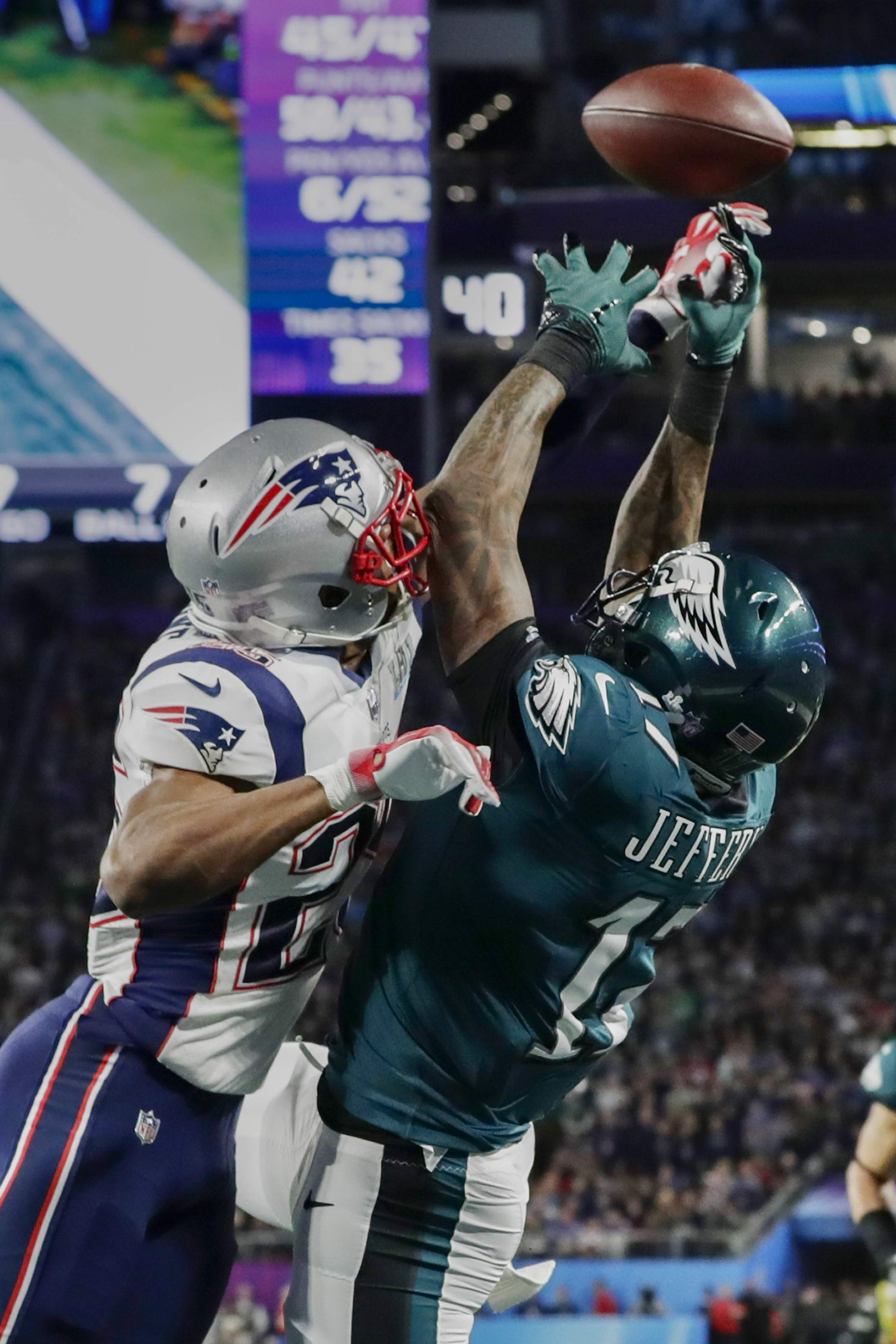 New England Patriots cornerback Eric Rowe (25) breaks up a pass in the end zone intended for Philadelphia Eagles wide receiver Alshon Jeffery (17), during the first half of the NFL Super Bowl 52 football game Sunday, Feb. 4, 2018, in Minneapolis. (AP Photo/Frank Franklin II)