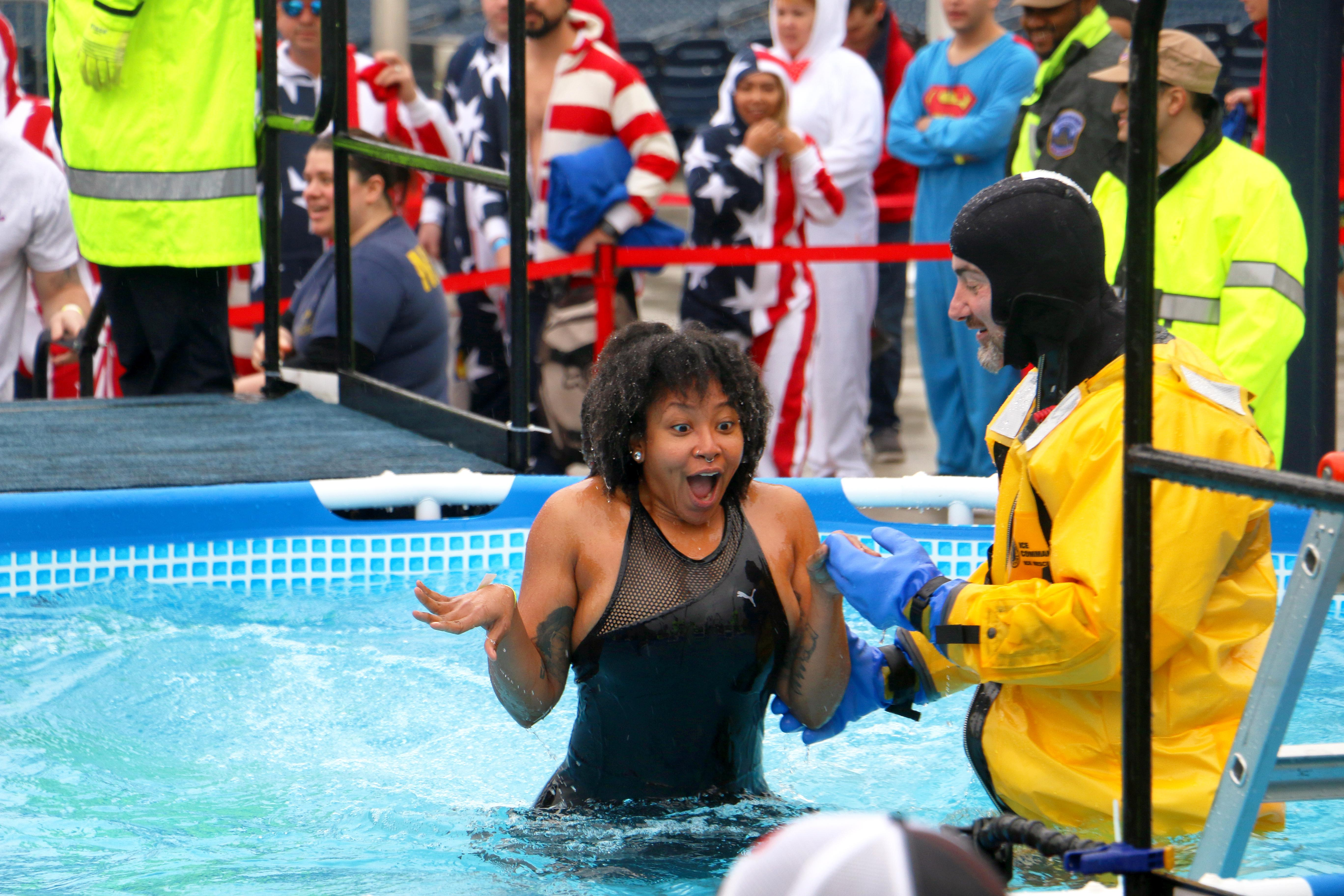 The Special Olympics D.C. Polar Plunge at National's Park had hundreds of plungers out in the rain to jump into above ground swimming pools to raise money for a great organization. Special Olympics D.C. directly supports the sports, health and inclusion programs that benefit over 1,600 children and adults with intellectual disabilities in the district. (Image: Jai Williams / DC Refined)