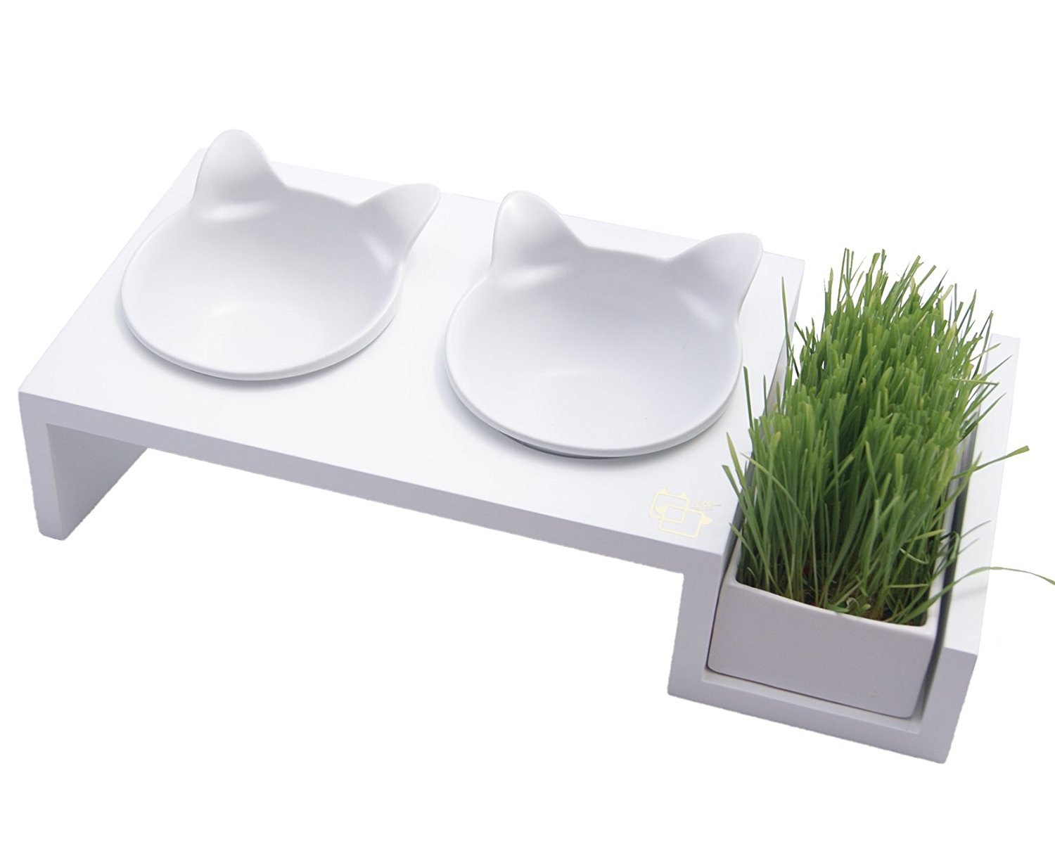 <p>From the Mykonos Collection comes the 15° tilted elevated pet feeder with a cat grass tray. Grow cat grass for your precious kitty or fill with filtered water. The tilted platform allows for easy eating and reduces stress on your pet's joints.{&amp;nbsp;} The hand crafted ceramic bowls are heat and dishwasher safe. Find it on Amazon. (Image: Amazon)</p>