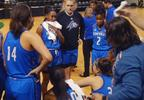 The UNC Asheville Bulldogs huddle during a second quarter timeout (WLOS Staff).jpg