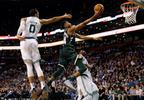 Milwaukee Bucks' Giannis Antetokounmpo, center, goes to the basket past Boston Celtics' Jayson Tatum (0) during the third quarter of an NBA basketball game in Boston, Monday, Dec. 4, 2017.
