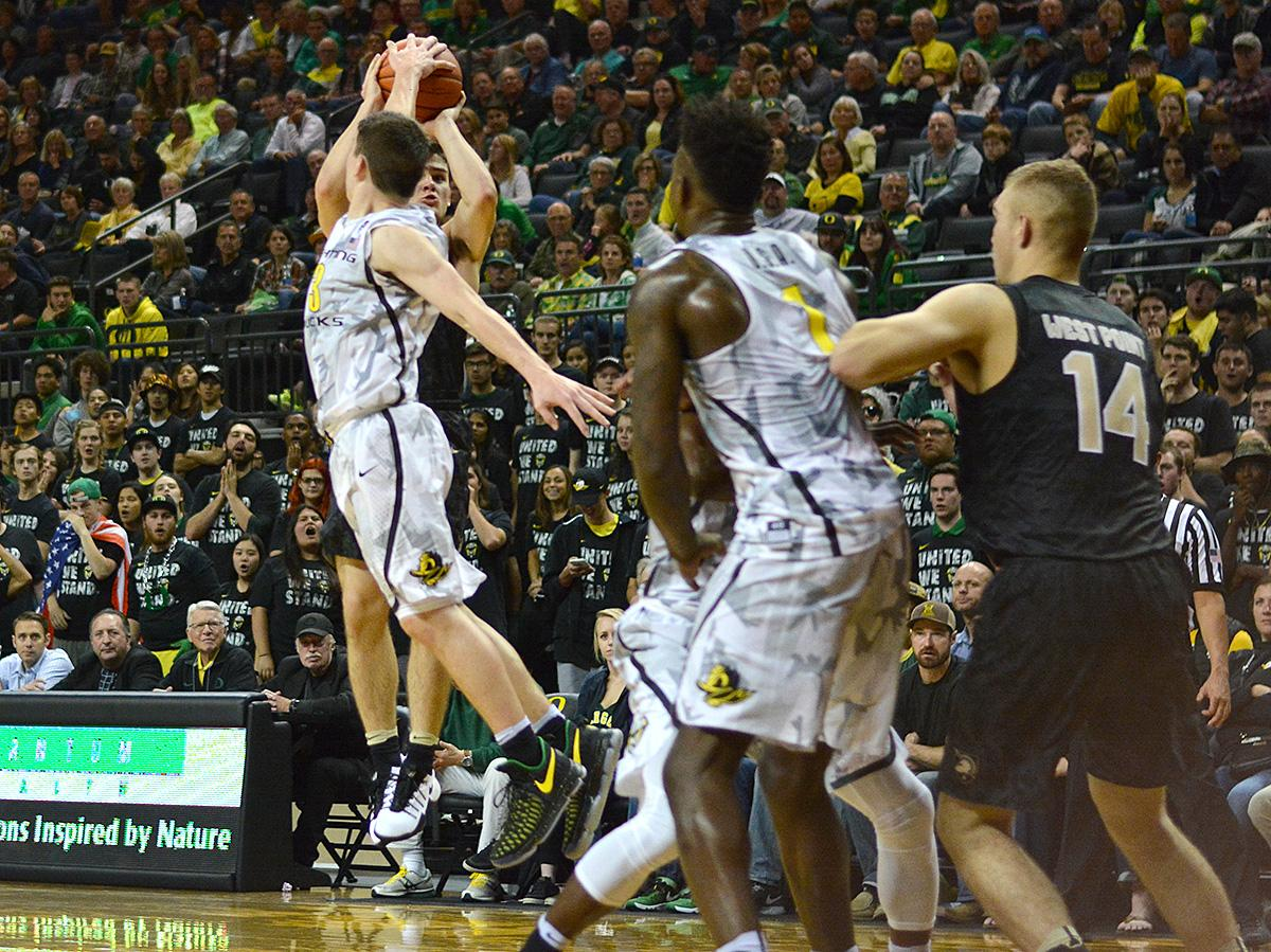 Ducks' Payton Pritchard (#3) blocks Army's Thomas Funk's (#11) shot. In front of a sold out crowd, Oregon defeated Army 91-77 on opening night. Photo by Jacob Smith, Oregon News Lab