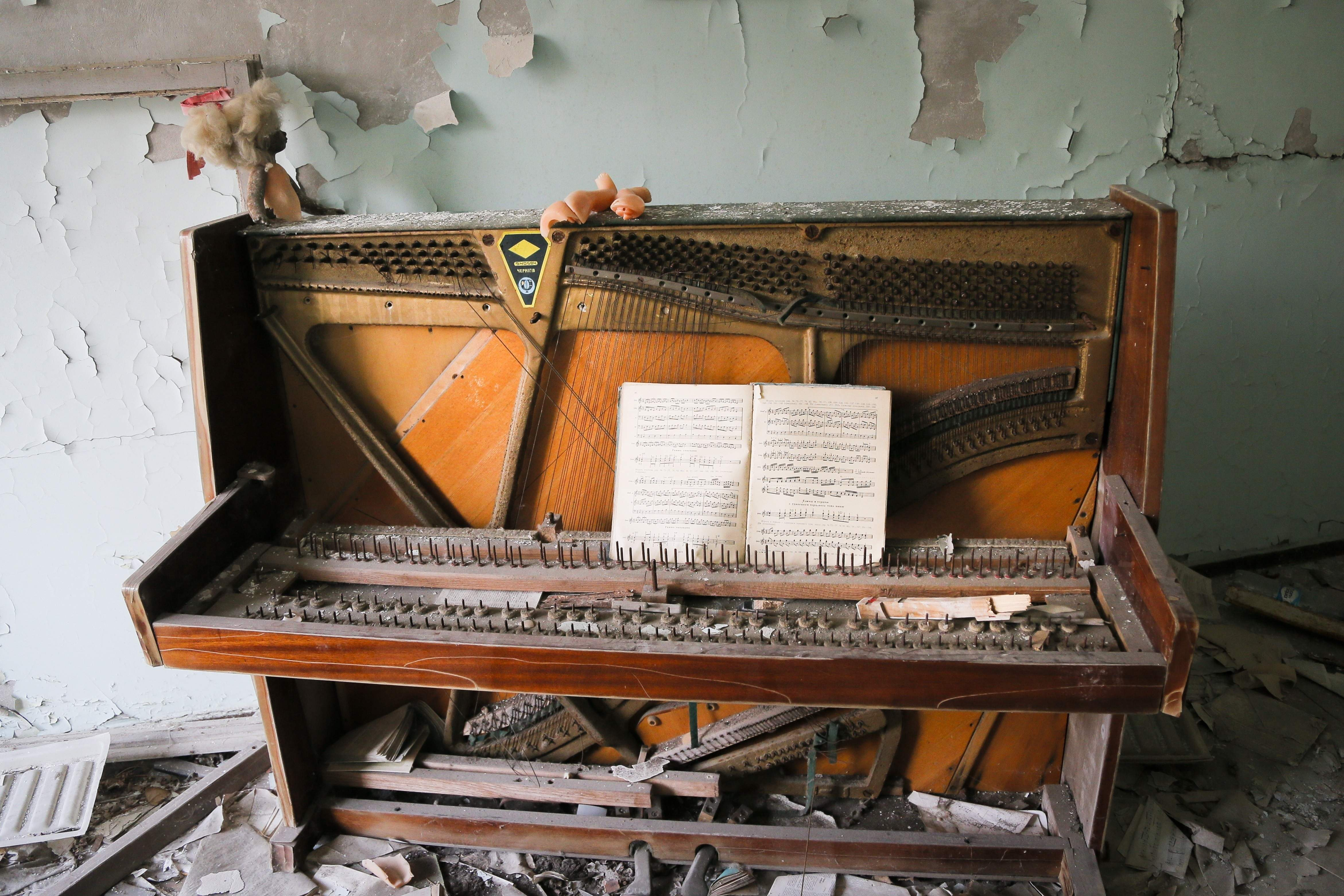 In this photo taken Wednesday, April 5, 2017, a decrepit piano stands in a school in the deserted town of Pripyat, some 3 kilometers (1.86 miles) from the Chernobyl nuclear power plant Ukraine. Once home to some 50,000 people whose lives were connected to the Chernobyl nuclear power plant, Pripyat was hastily evacuated one day after a reactor at the plant 3 kilometers (2 miles away) exploded on April 26, 1986. The explosion and the subsequent fire spewed a radioactive plume over much of northern Europe. THE ASSOCIATED PRESS