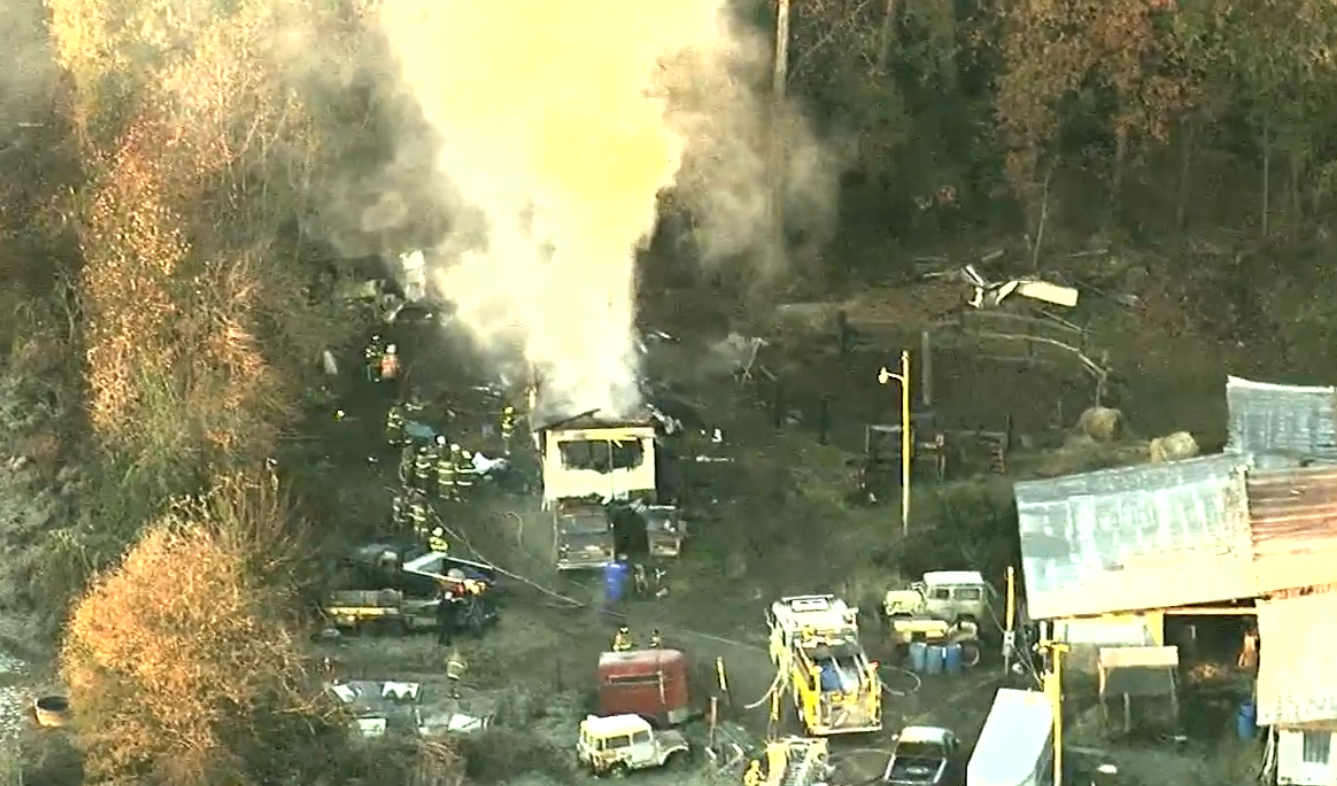 A man is dead after he was found in a burning mobile home in Charles County. (Photo, ABC7)