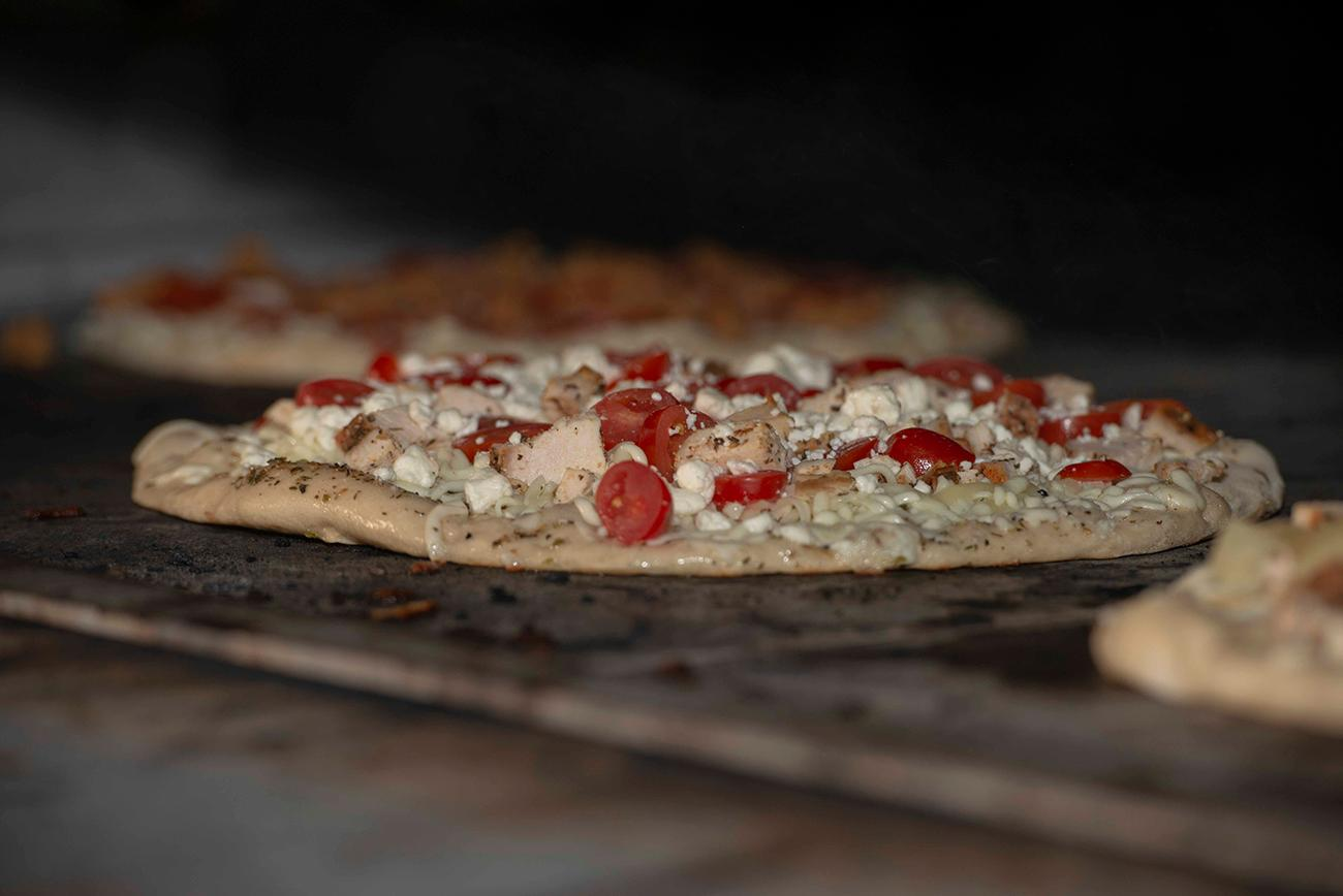 Chicken, tomato, and cheese pizza{ }/ Image: Joe Simon // Published: 3.10.19