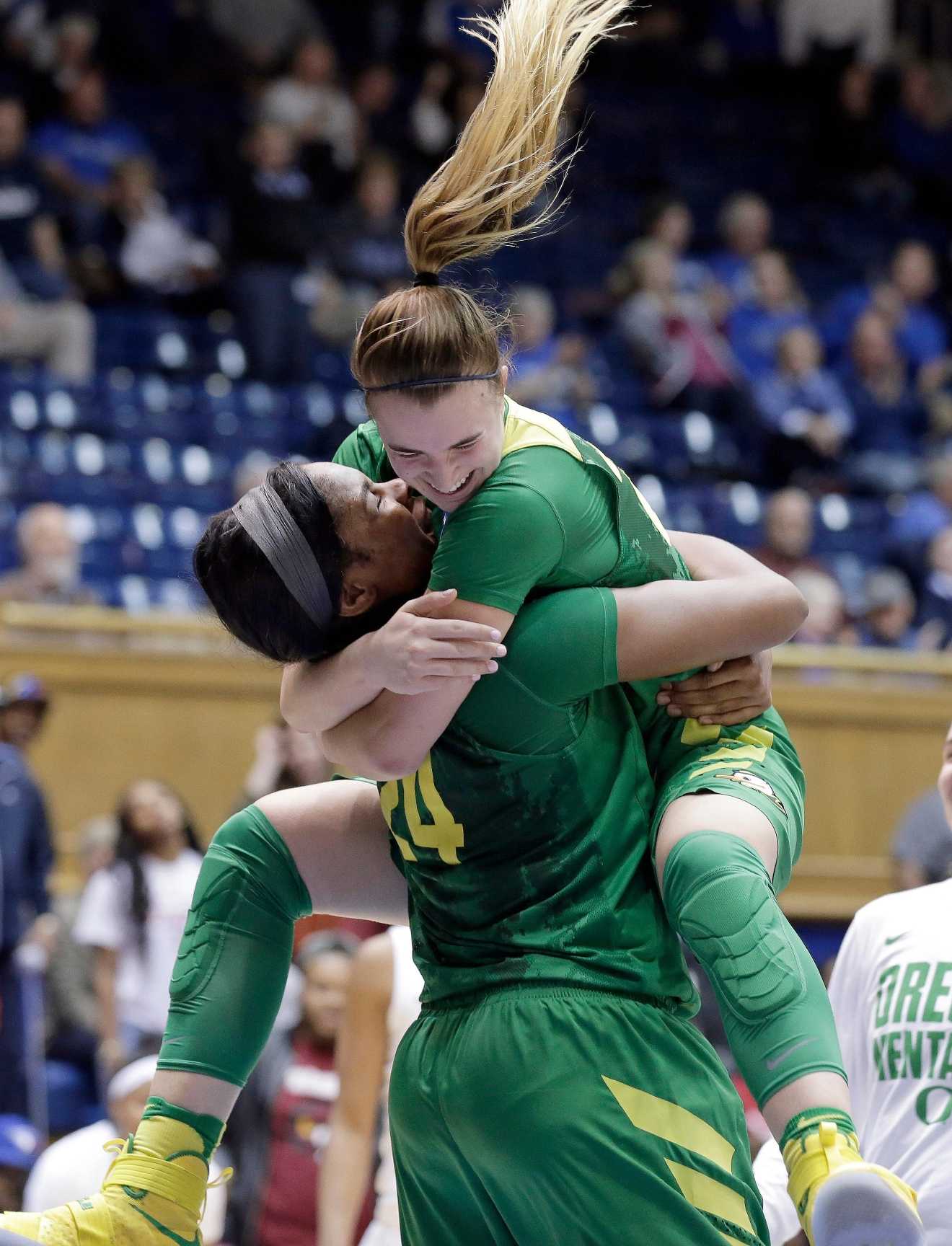 Oregon's Sabrina Ionescu jumps into the arms of Ruthy Hebard (24) following Hebard's late shot to put Oregon ahead during the second half of a first-round game in the NCAA women's college basketball tournament in Durham, N.C., Saturday, March 18, 2017. Oregon won 71-70. (AP Photo/Gerry Broome)
