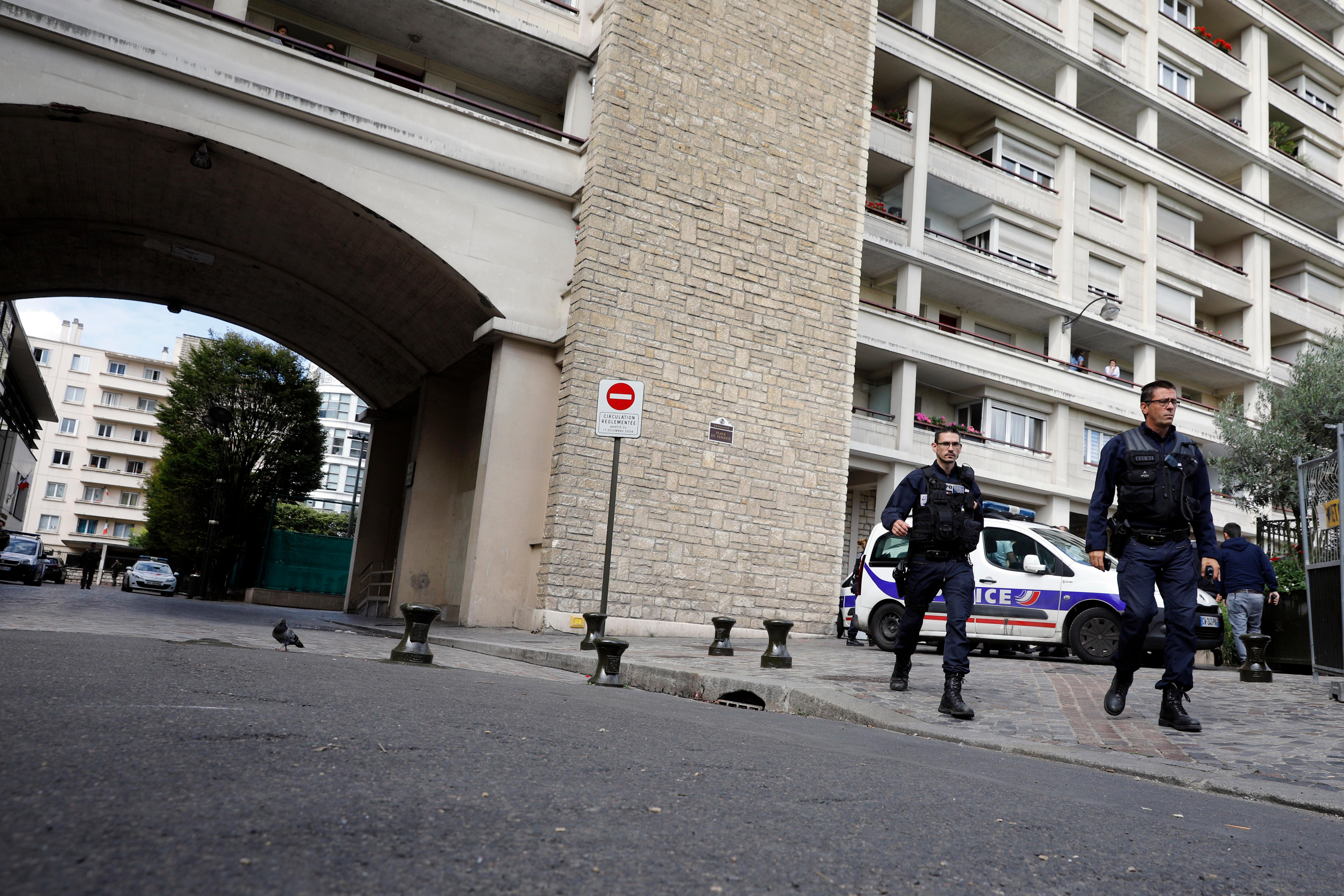 French police officers work near the scene where French soldiers were hit and injured by a vehicle in the western Paris suburb of Levallois-Perret near Paris, France, Wednesday, Aug. 9, 2017. French police are searching for a driver who slammed his BMW into a group of soldiers, injuring six of them in an apparent ambush before speeding away, officials said. The incident in Levallois, northwest of Paris, is the latest of several attacks targeting security forces in France.(AP Photo/Kamil Zihnioglu)