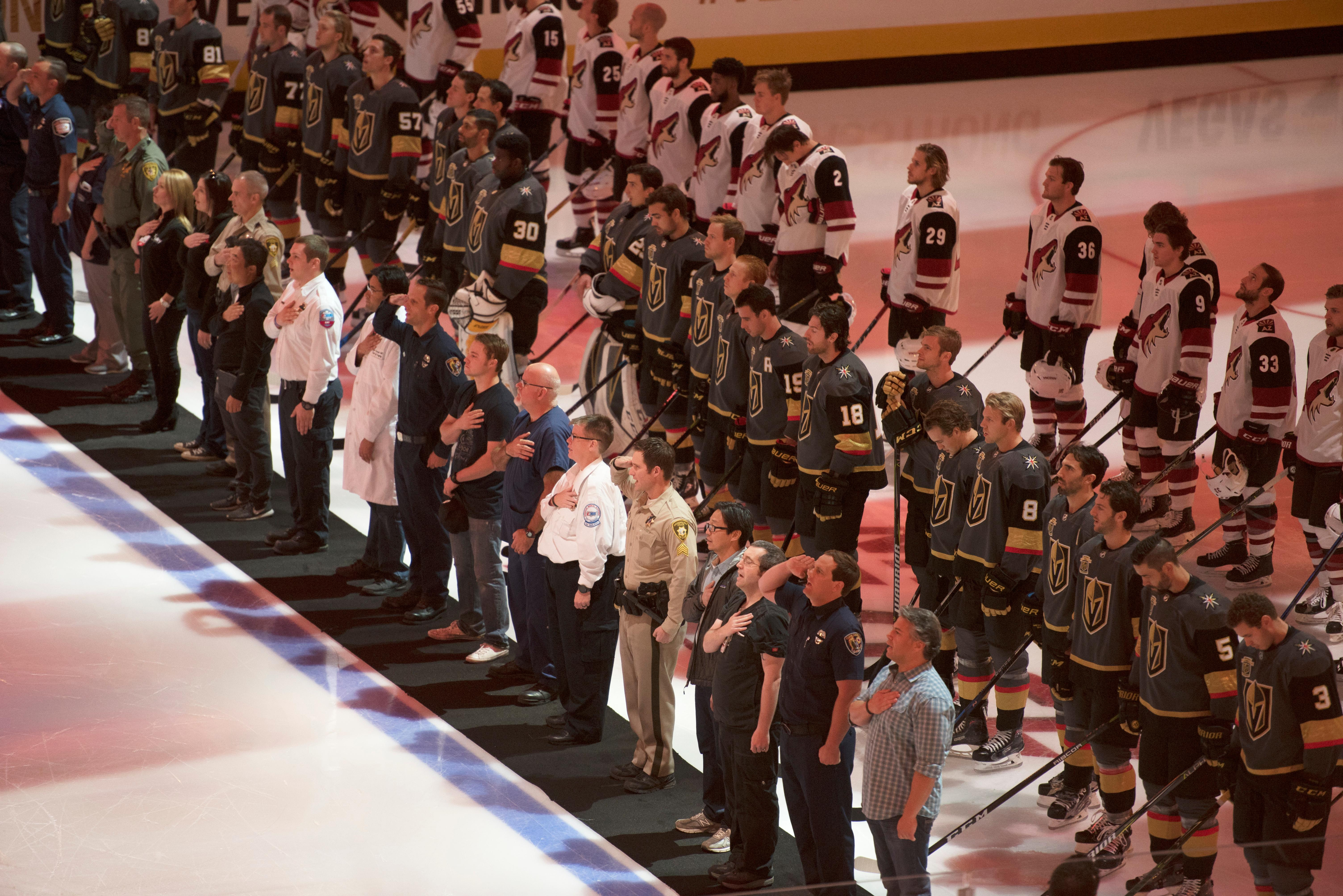First responders and medical personnel involved in the October 1st tragedy are backed by the Vegas Golden Knights and Arizona Coyotes for the singing of the national anthem during the Knights home opener Tuesday, Oct. 10, 2017, at the T-Mobile Arena. The Knights won 5-2 to extend their winning streak to 3-0. CREDIT: Sam Morris/Las Vegas News Bureau