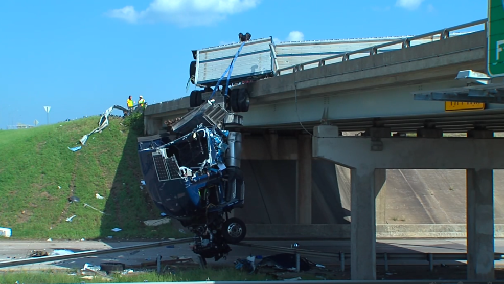 Crash leaves big rig dangling off Oklahoma highway overpass