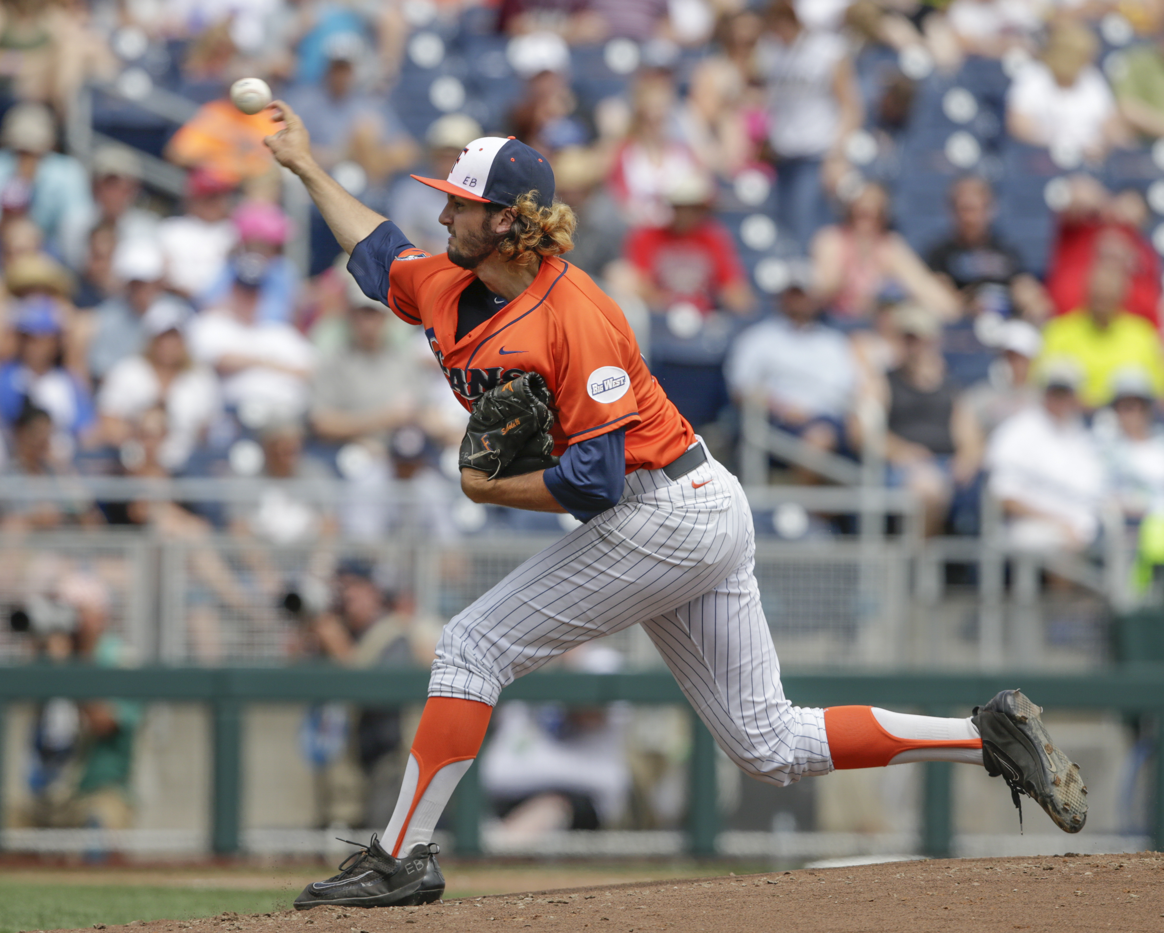 Cal State Fullerton pitcher Connor Seabold (26) throws against Oregon State in the first inning of an NCAA mens College World Series baseball game in Omaha, Neb., Saturday, June 17, 2017. (AP Photo/Nati Harnik)