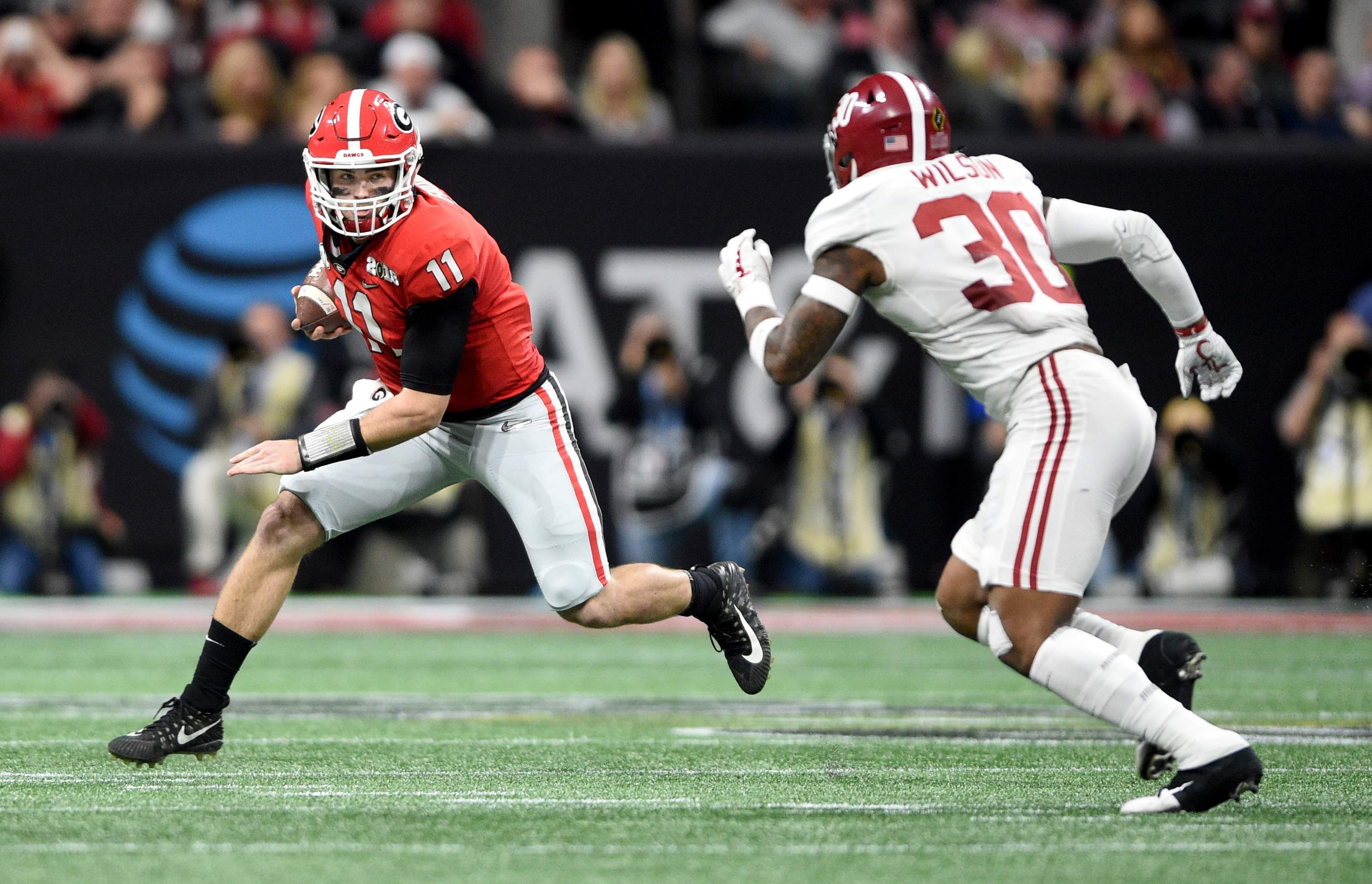 Georgia quarterback Jake Fromm tries to elude Alabama's Mack Wilson during the 2018 College Football Playoff National Championship at Mercedes-Benz Stadium in Atlanta, Ga., Monday evening January 8, 2018. MICHAEL HOLAHAN/AUGUSTA CHRONICLE