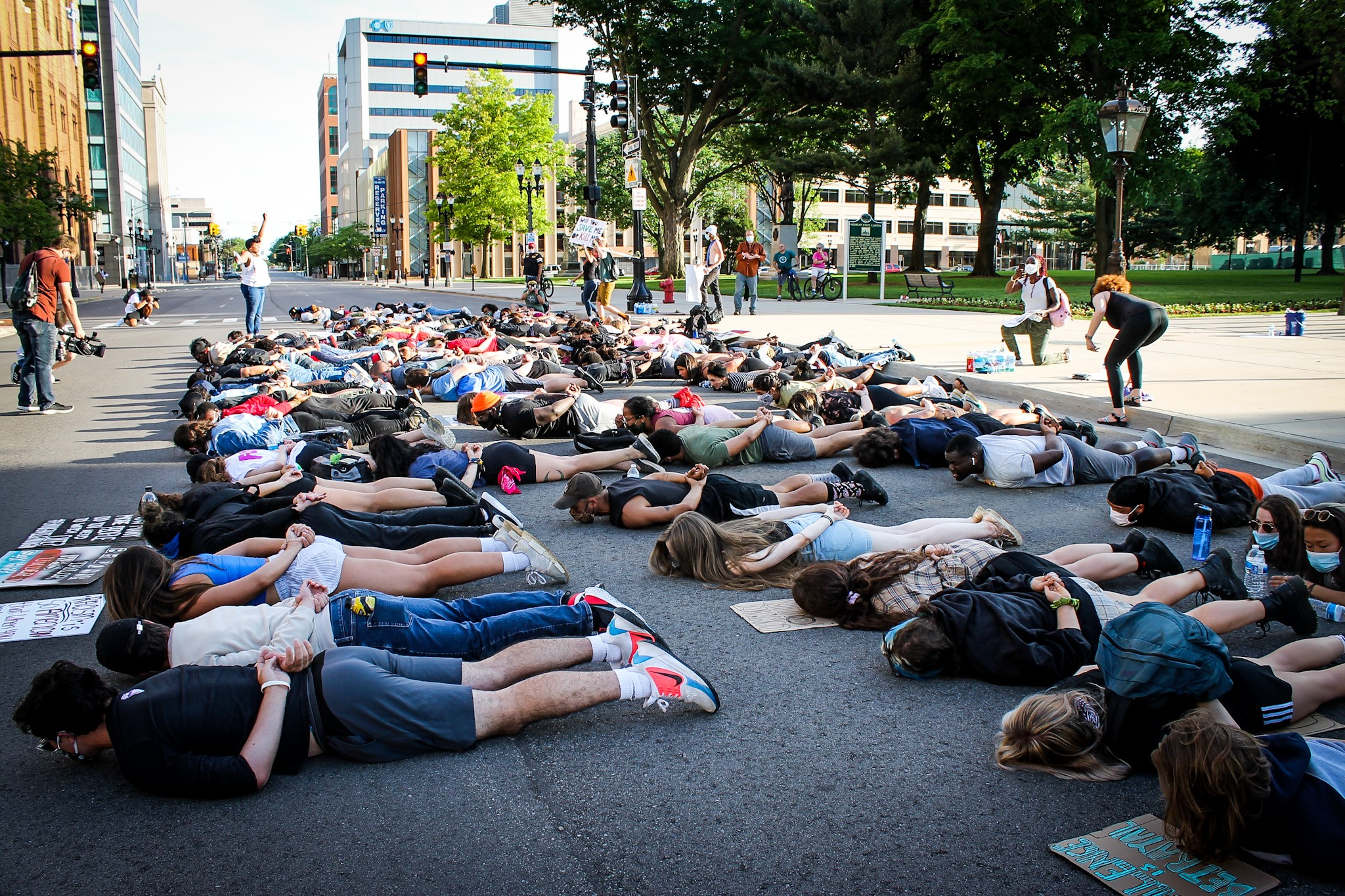 Protesters lay in the street at intersection of Capitol and Michigan Avenue in Lansing.{ } (WWMT/Mikenzie Frost)
