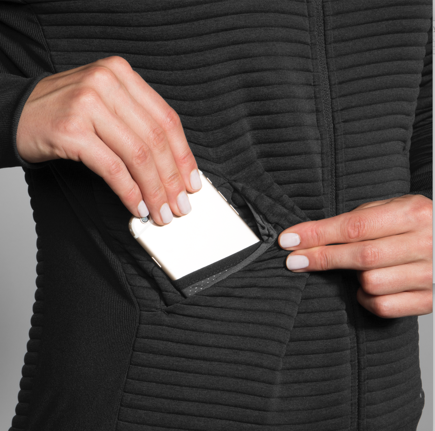 Before you ask, yes - the pockets fit iPhones. (Image: Brooks Running)