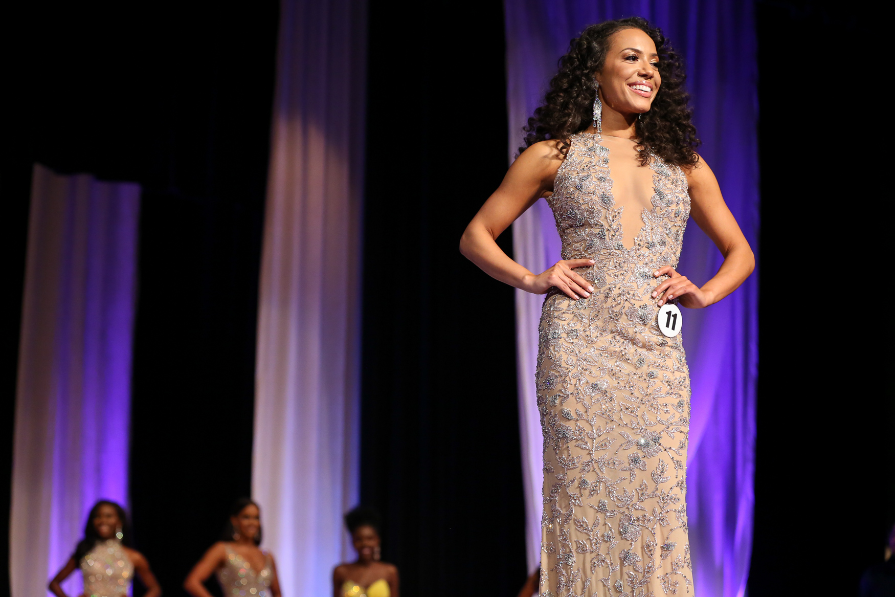 After an intense weekend of competition on the theater stage at the University of District of Columbia, Cordelia Crenshaw was officially been crowned the new Miss District of Columbia USA on December 8. Crenshaw competed in a swimsuit, a ball gown and showed off her quick wits during a brief question-and-answer period, but her openness about her personal struggles set her apart. Crenshaw's mother was incarcerated and her father struggled with alcoholism, but she persevered{&amp;nbsp;}and made it to college and now advocated for youth. Her younger counterpart is Jaclyn Davis, who was crowned Miss Teen District of Columbia USA. The two of them will go on to compete at a national level. (Amanda Andrade-Rhoades/DC Refined){&amp;nbsp;}<br>
