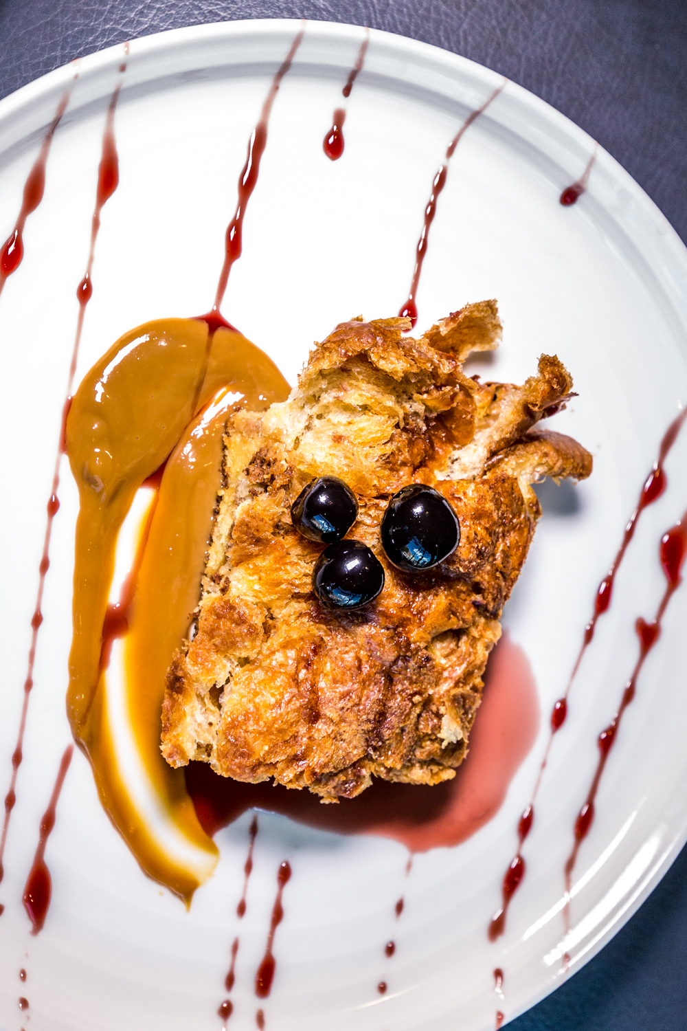 Parlor Bread Pudding: buttery and soft croissant bread pudding with homemade warm caramel sauce, Luxardo cherries, and cherry cordial drizzle / Image: Catherine Viox // Published: 10.10.19