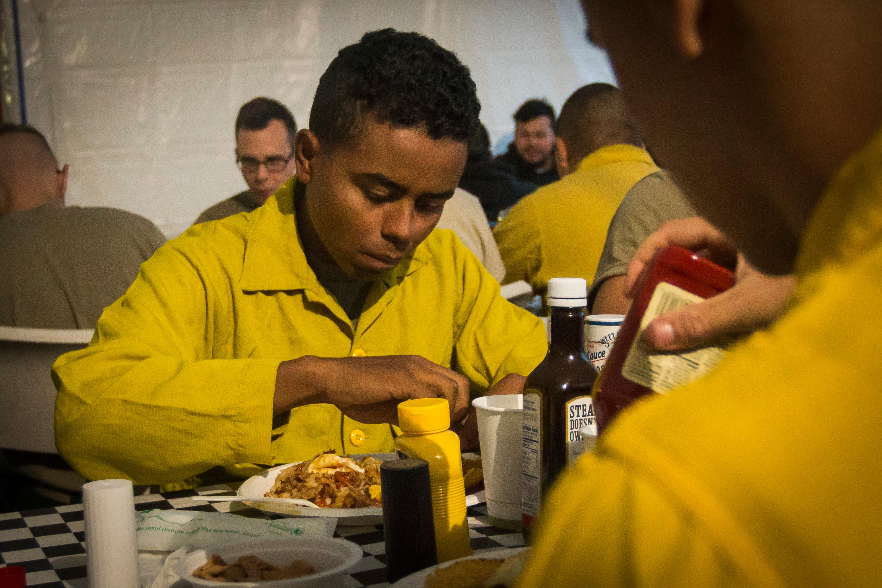 A U.S. Army Soldier assigned to 23rd Brigade Engineer Battalion, 1-2 Stryker Brigade Combat Team starts the day off right with a hearty breakfast at Glide Base Camp, Oregon, Sept. 8th. The Soldiers, having recently arrived at camp, will begin the first part of their tactical training to support the suppression of wildfires in the Umpqua North Complex in Oregon. (U.S. Army photo by Pvt. Adeline Witherspoon, 20th Public Affairs Detachment)