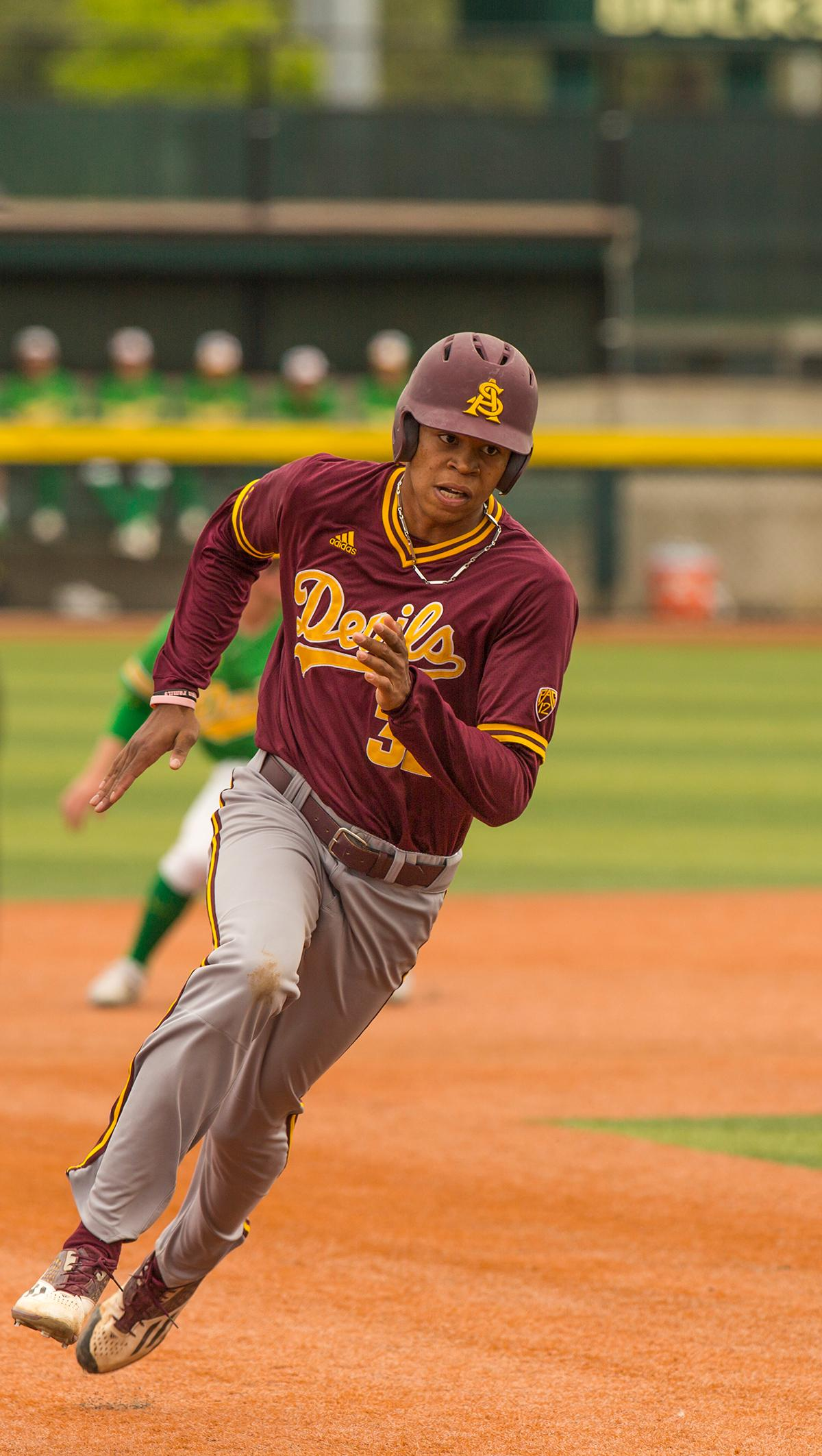 Sun Devils Garvin Alston Jr.(#32) dashes for third base. Despite a late comeback, the Ducks fall to Arizona State Sun Devils 4-3 in the second game of a three-game series. Photo by James Wegter, Oregon News Lab