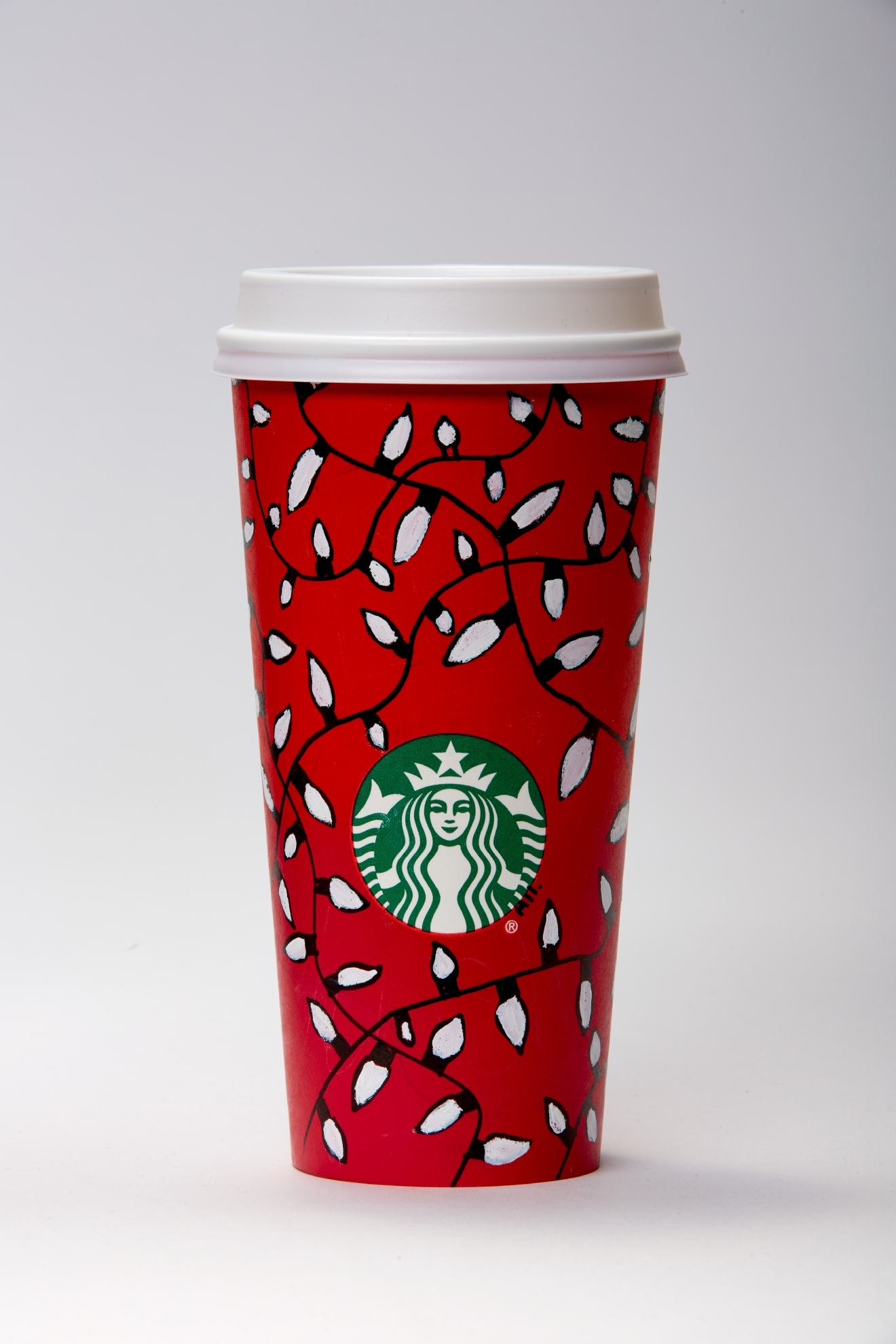 "Red Cup Season is officially here! Regardless of how you felt about the Green Cups, there is little to no way to be upset about the Red Cup designs this year. Why? Well for starters, there are 13 of them! Don't like one? That's ok, you have 12 others to choose from. What's even better is that all 13 of these designs came from customers who submitted them to Starbucks via Instagram. The final 13 designs were chosen from over 1,200 submissions, and come from six different countries. ""We were surprised and inspired by the amount of incredible art submitted by our customers. The designs were beautiful, expressive and engaging,"" said Dena Blevins, creative director, Starbucks Global Creative Studio. Red cups are available in Starbucks stores starting November 10, 2016. (Image: Starbucks)"