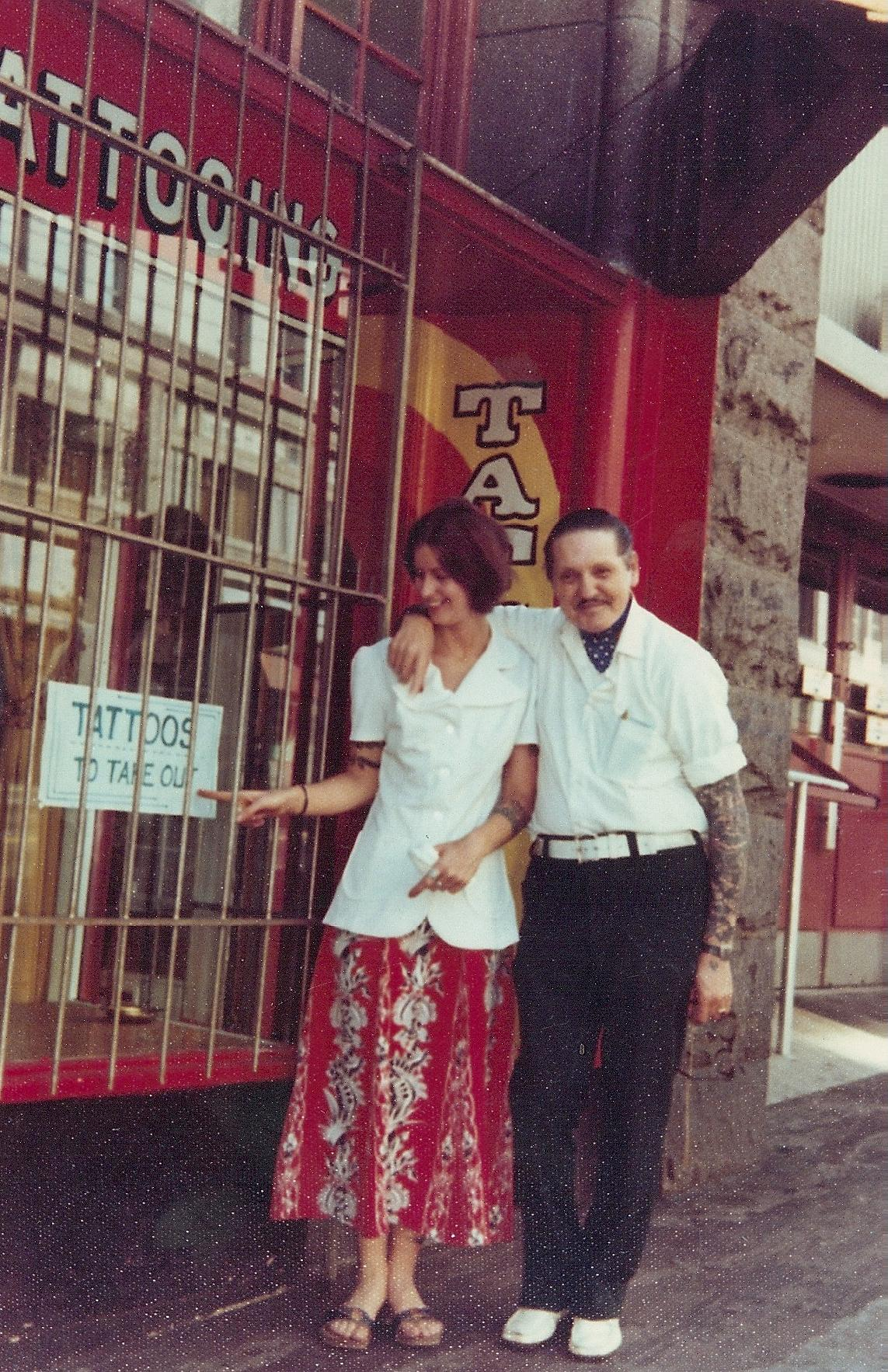 "<p>Vyvyn ""Madame"" Lazonga stands with mentor C.J. ""Danny"" Danzel outside of his tattoo parlor in Seattle in the '70s. (Image: Vyvyn Lazonga)</p>"