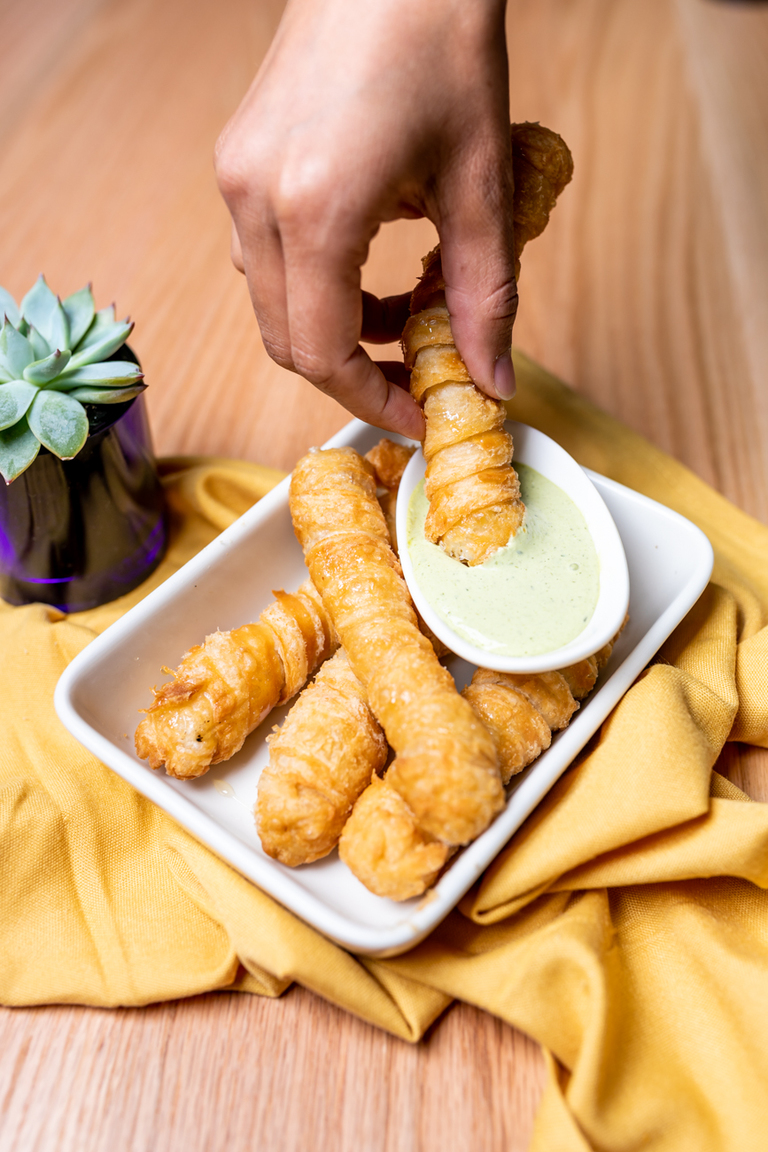 Tequenos: Crispy Venezuelan cheese pastries serves with a cilantro dipping sauce / Image: Amy Elisabeth Spasoff // Published: 8.1.18