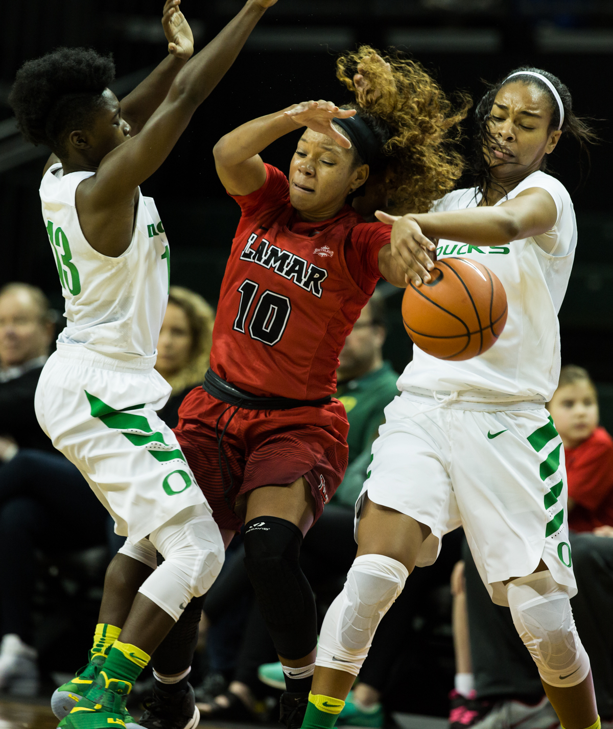 Lamar Cardinals guard Chastadie Barrs (#10) is stripped by Ducks guard Jayde Woods (#11). The Oregon Ducks Women's basketball team won their season opener against the Lamar Cardinals 84-67.  Photo by Austin Hicks, Oregon News Lab