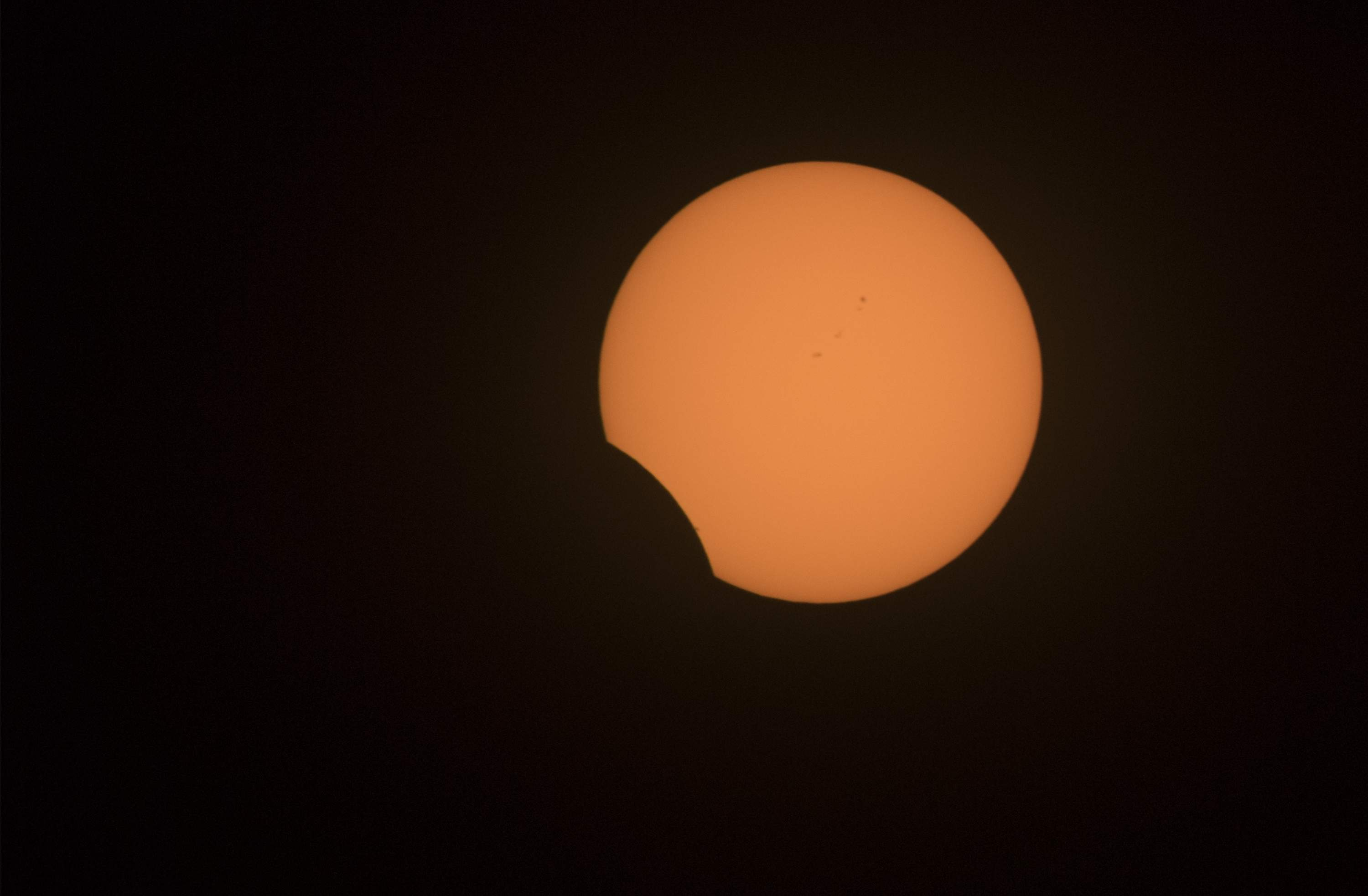 The partial solar eclipse is nearly finished at about 11:30 a.m. in Stockton. [CLIFFORD OTO/THE RECORD]