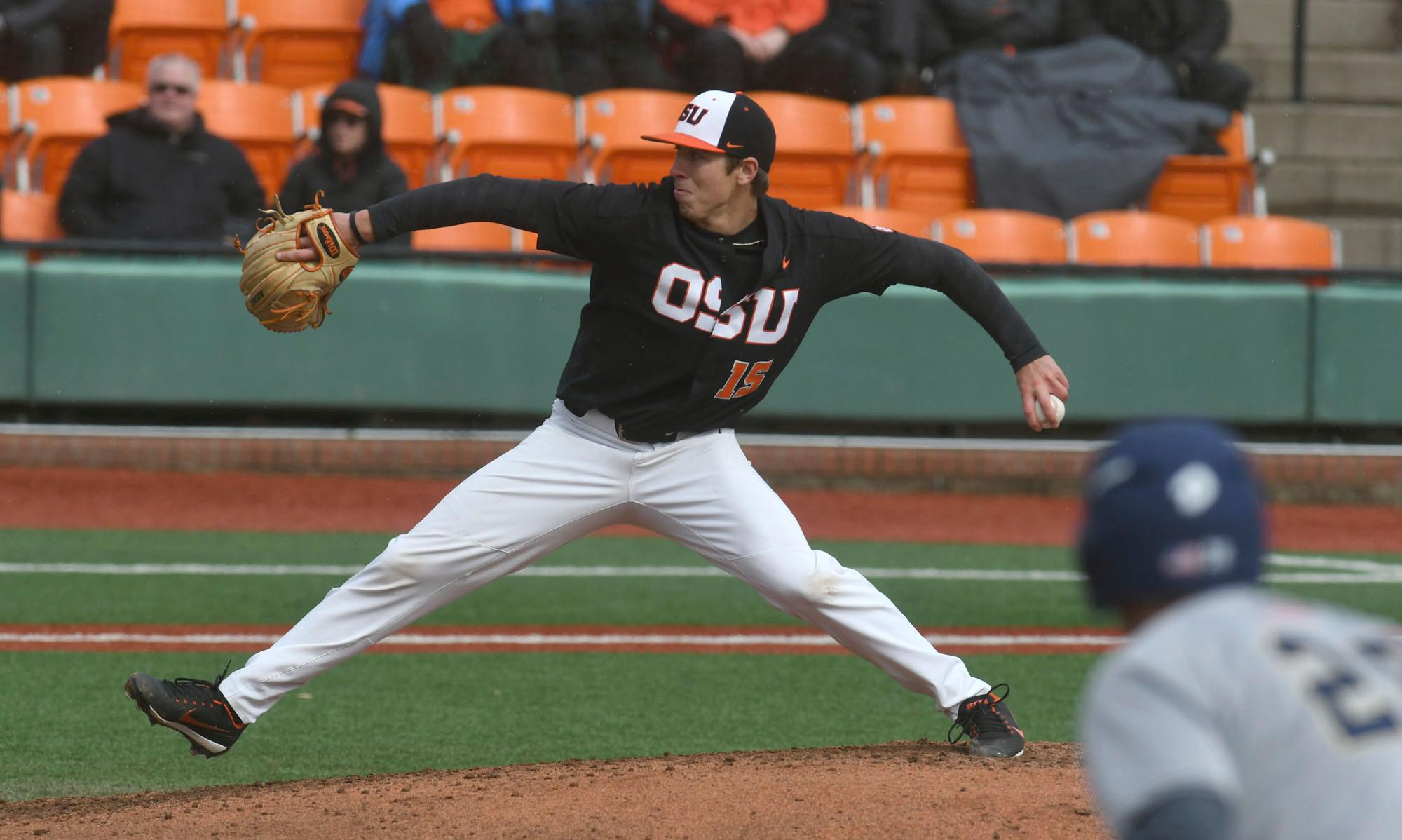 In this March 4, 2017 photo, Oregon State pitcher Luke Heimlich delivers a pitch against UC Davis during an NCAA college baseball game in Corvallis, Ore.  Heimlich, a standout pitcher for Oregon State's top-ranked baseball team, pleaded guilty to a single count of molesting a 6-year-old girl when he was a teenager.  Heimlich's criminal history was reported by The Oregonian/OregonLive on Thursday, June 8, 2017. The newspaper says it learned about the 2012 conviction while doing a routine background check on Heimlich before running a profile on him.  (Mark Ylen/Albany Democrat-Herald via AP)