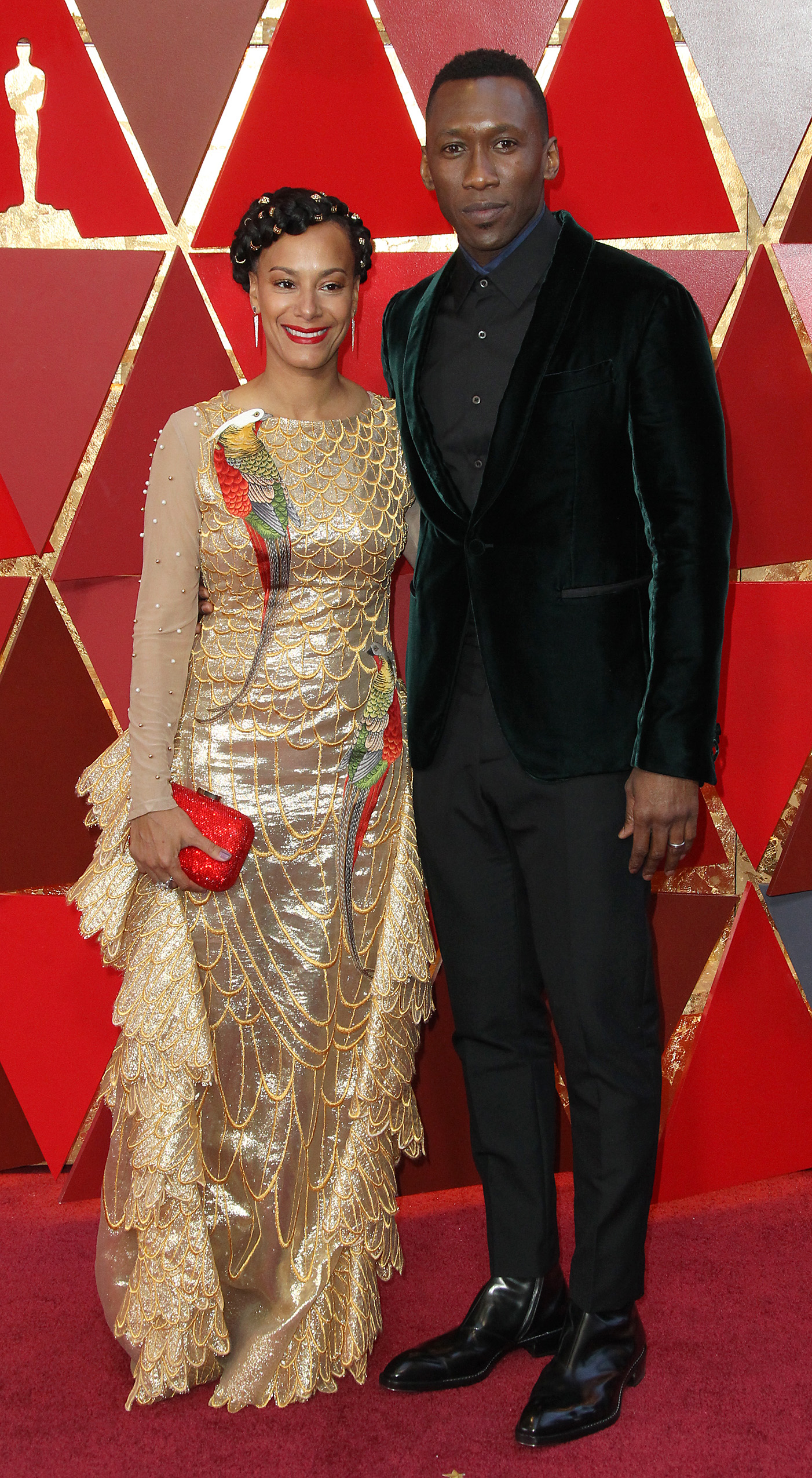 Fatherhood looks gooooood on Mahershala! The Moonlight star, who became the first Muslim actor to win an Oscar last year, couldn't stop gushing about what a blessing his one-year-old daughter was as he sported a dark emerald velvet Berluti tux, while his wife opted for a gold gown adorned with birds. (Image: Adriana M. Barraza/WENN.com)<p></p>
