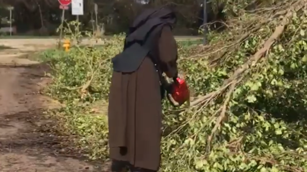 Nun cutting a tree3.PNG