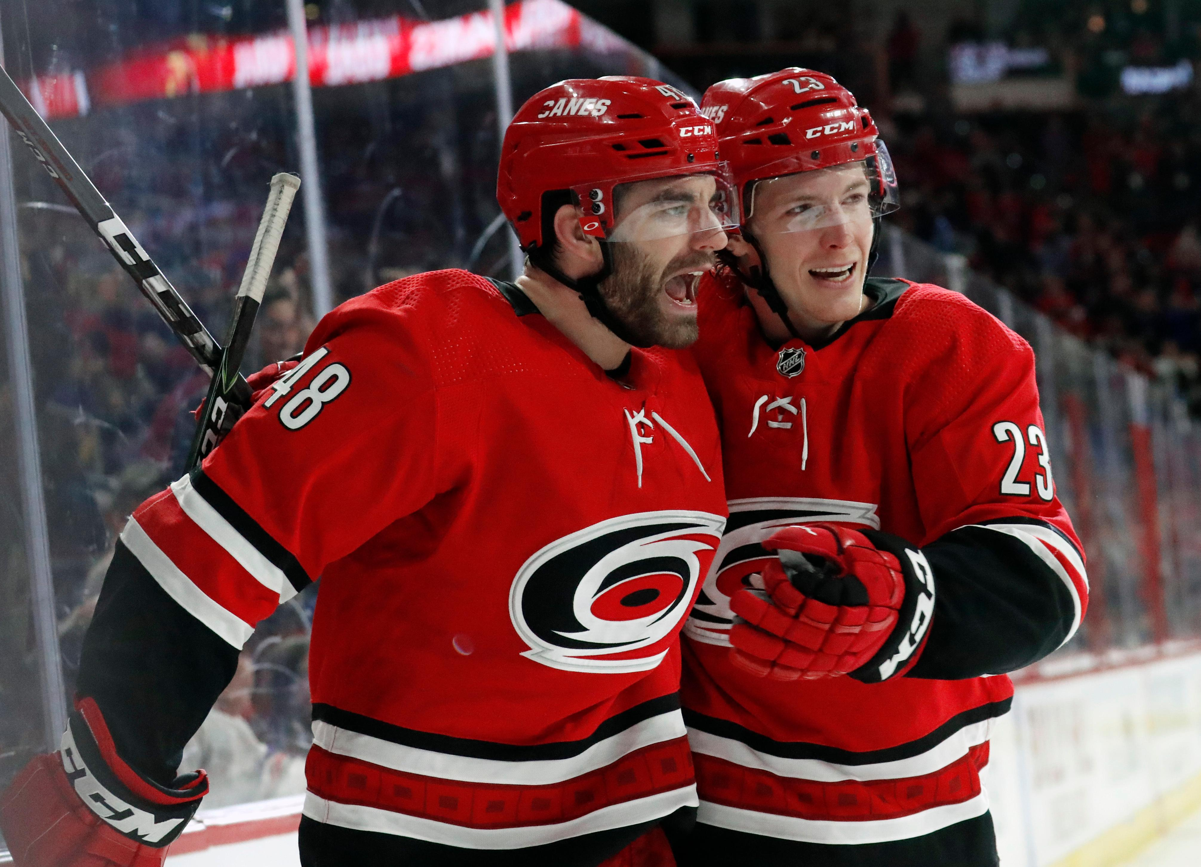 Carolina Hurricanes' Jordan Martinook (48) celebrates his goal with Brock McGinn (23) during the second period of an NHL hockey game against the New York Rangers in Raleigh, N.C., Tuesday, Feb. 19, 2019. (AP Photo/Chris Seward)