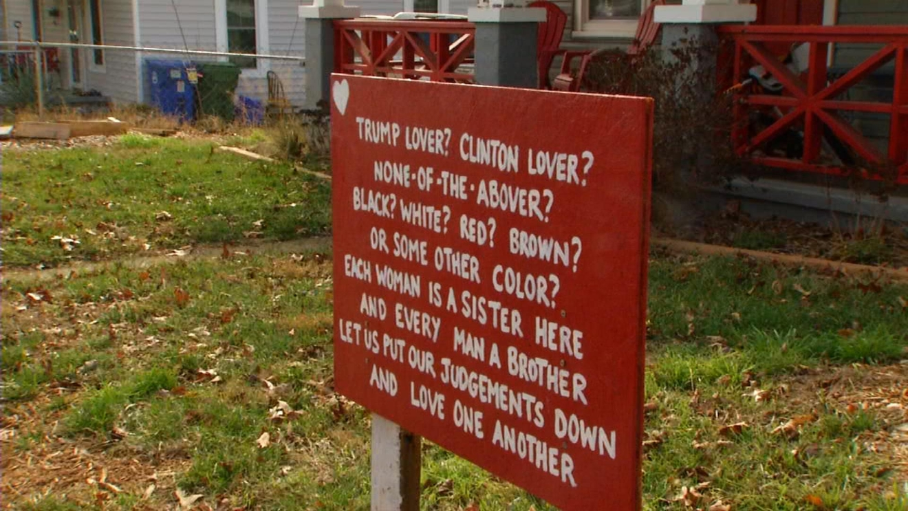 If you've walked up to Sunny Point Cafe in West Asheville via State Street, you might have spotted this sign in front of a house. (Photo credit: WLOS staff)