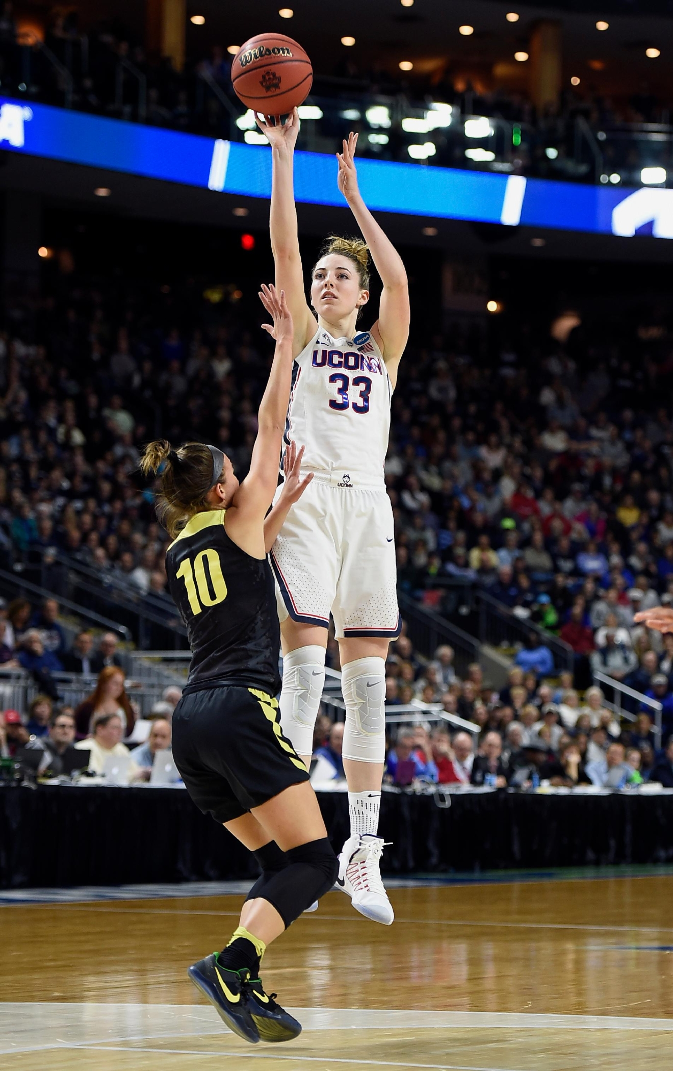 Connecticut's Katie Lou Samuelson shoots over Oregon's Lexi Bando, left, during the first half of a regional final game in the NCAA women's college basketball tournament, Monday, March 27, 2017, in Bridgeport, Conn. (AP Photo/Jessica Hill)