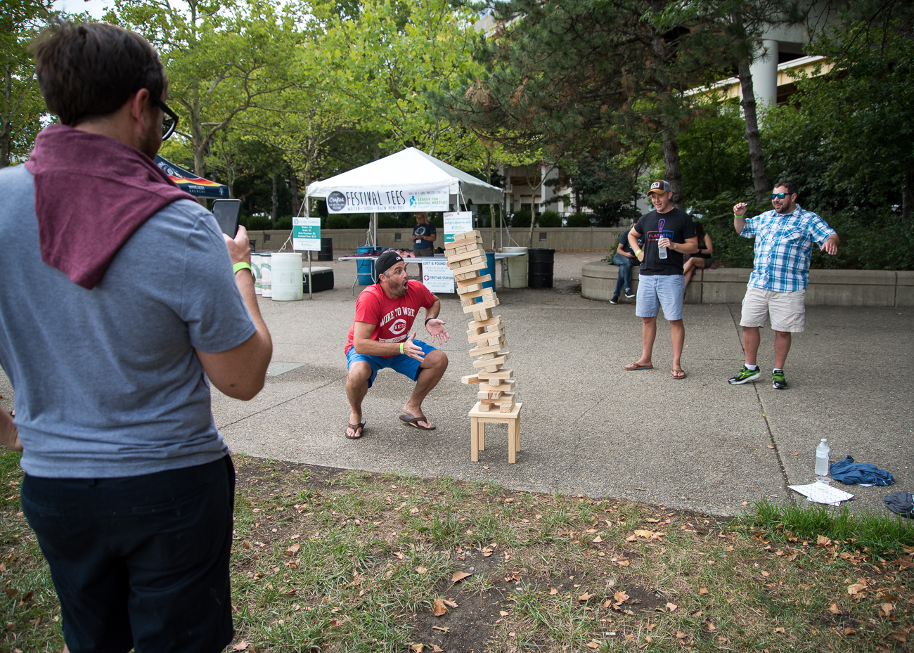 Friends watch as a very long game of Jenga ends / Image: Amie Santavicca // Published: 7.22.18