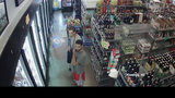 Surveillance photos released after larceny at liquor store