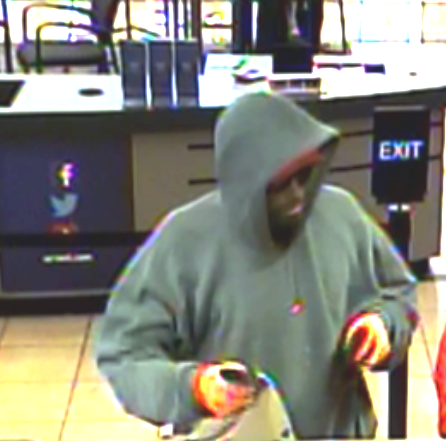 A suspect wearing a gray hoodie, orange gloves and a red hat robbed Arvest near 43rd and Garnett Wednesday, Nov. 8, 2017.{&amp;nbsp;} Police say he implied a weapon but no gun was ever seen. (TPD)<p></p>