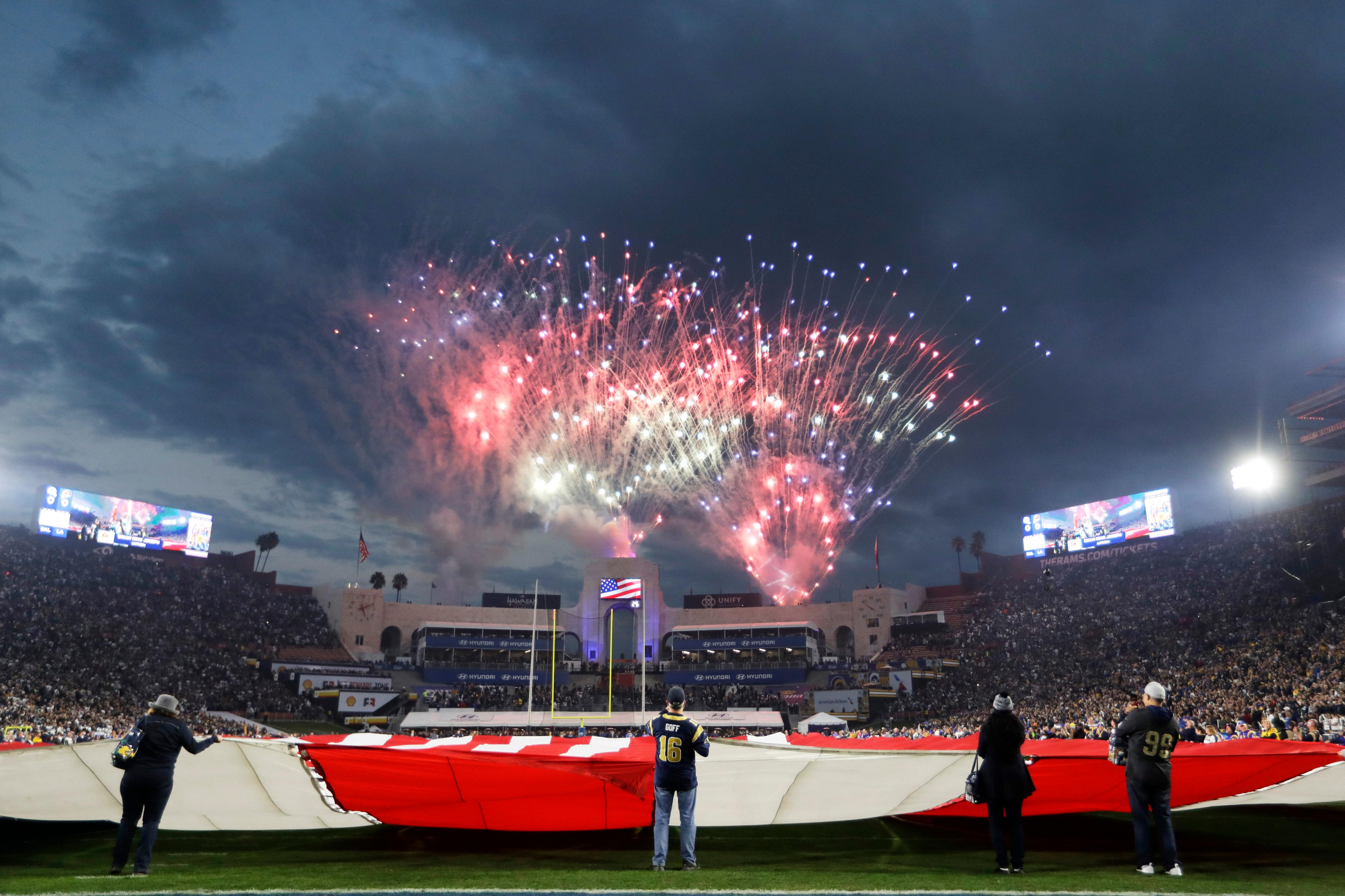 Fireworks explode over the field before an NFL divisional football playoff game between the Los Angeles Rams and the Dallas Cowboys, Saturday, Jan. 12, 2019, in Los Angeles. (AP Photo/Jae C. Hong)