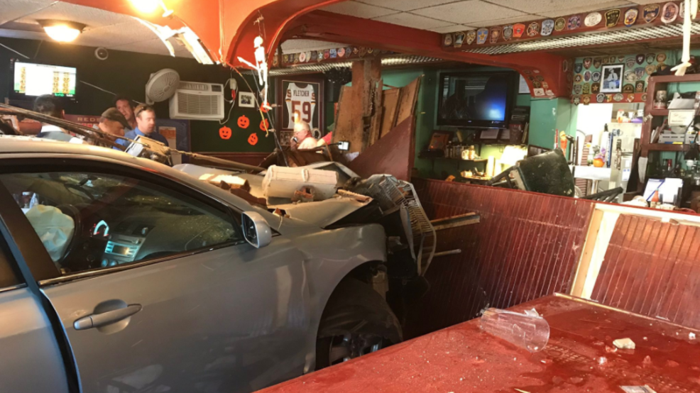 Surveillance video shows car crashing into tavern, creating rapid ...